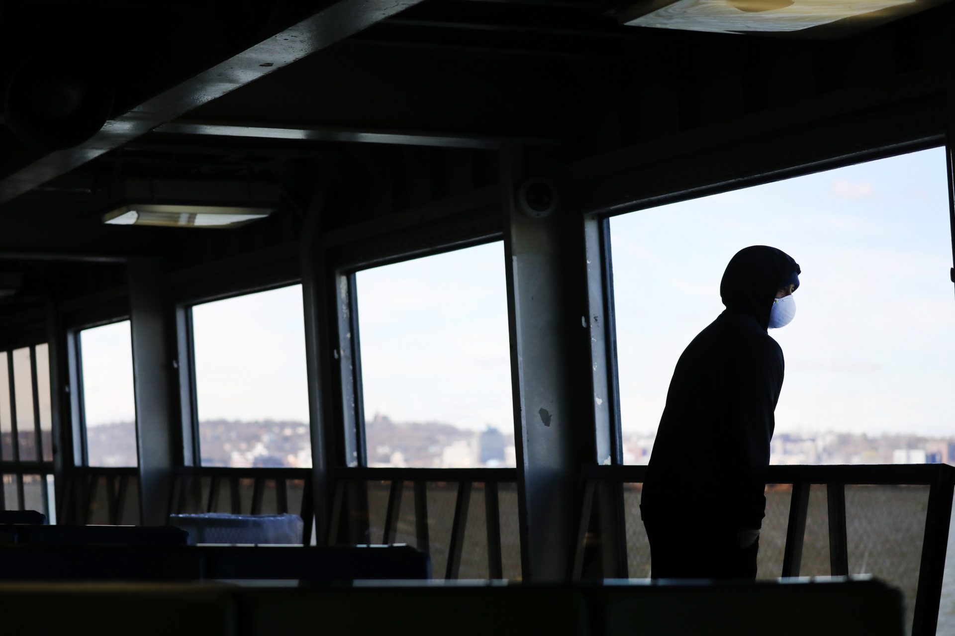 """Tremaine Fredericks rides a nearly empty Staten Island Ferry to Manhattan in New York City. Governor Andrew Cuomo's """"New York State on PAUSE"""" executive order went into effect on March 22, 2020."""