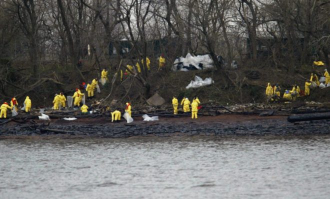 Work crews clean oil off the banks of the Delaware River in National Park, N.J., Monday, Dec. 6, 2004. The Athos I spilled as much as 470,000 gallons of thick crude oil into the Delaware River, killing wildlife and spreading along 70 miles of the waterway.