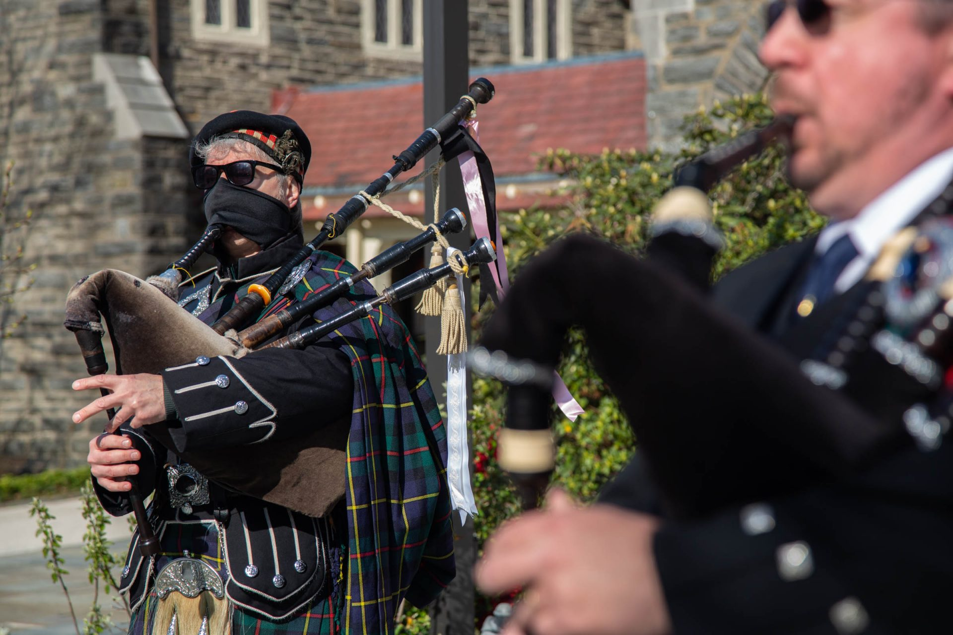 A bagpiper from Philadelphia, who wished to remain anonymous, wears a face mask while playing to bring Easter joy to a neighborhood in Chestnut Hill. (