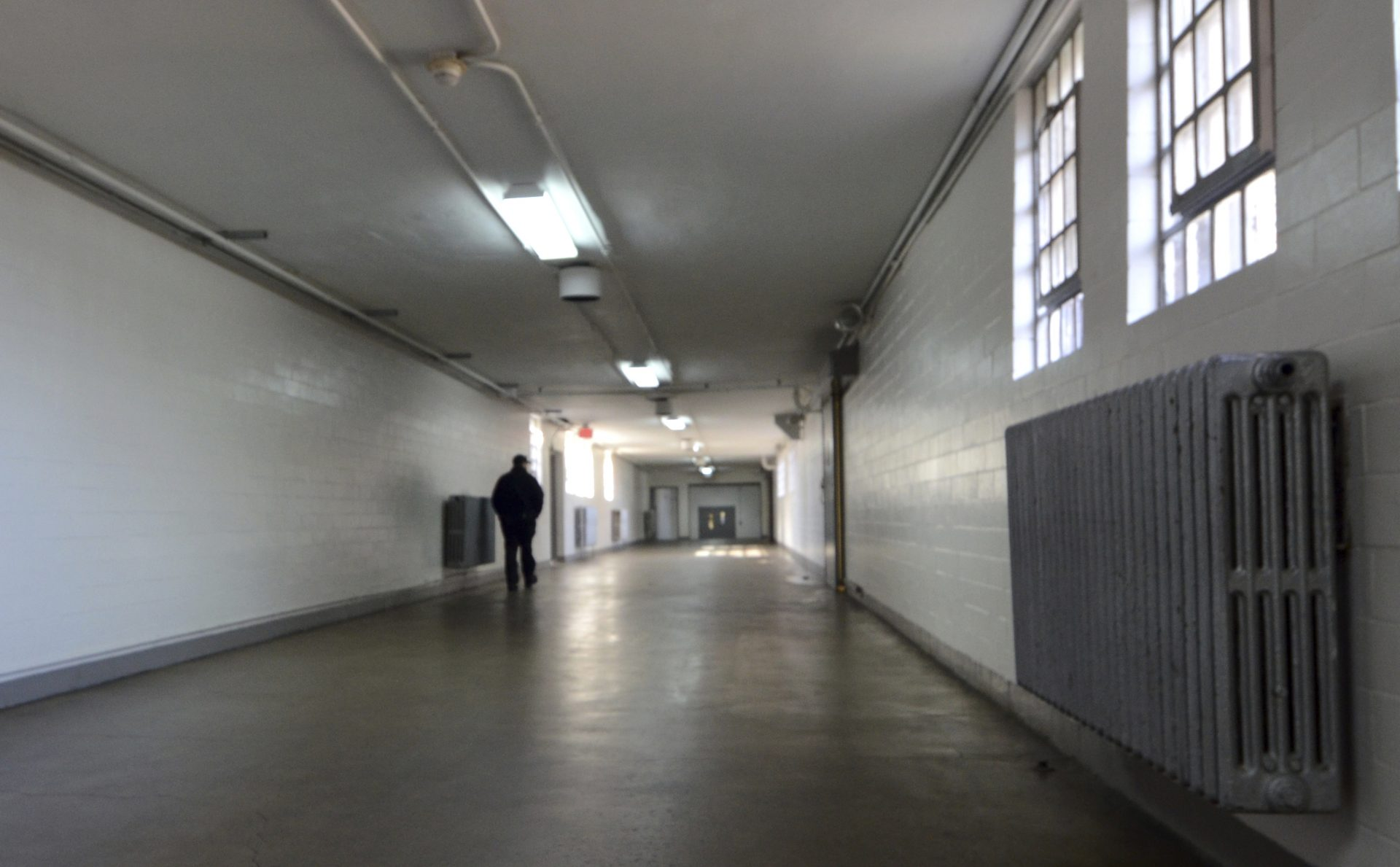 A corrections officer walks down a hallway in a building at the State Correctional Institution at Camp Hill, Pennsylvania, on Jan. 13, 2017, in Camp Hill, Pa.