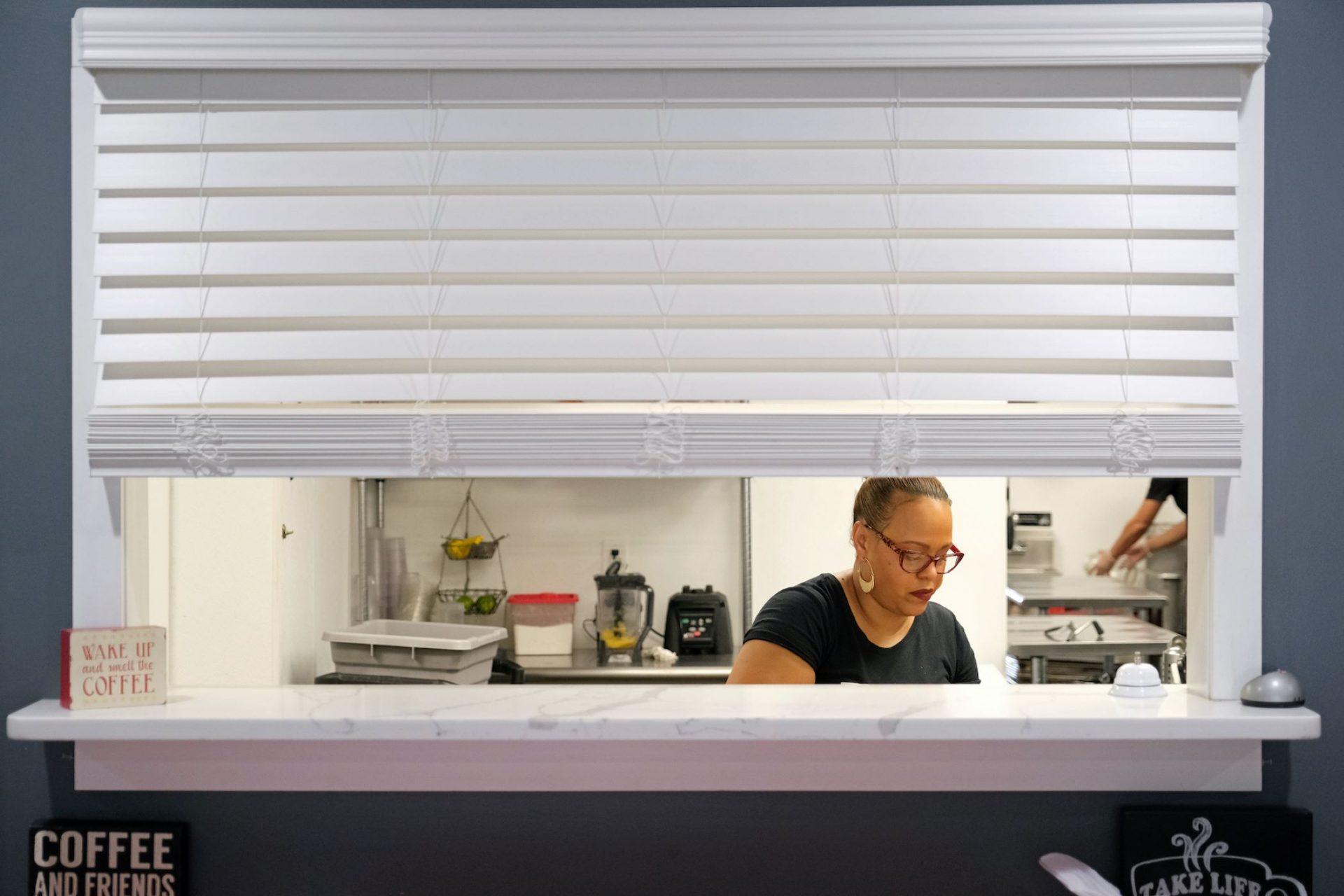 Johanny Cepeda-Freytiz works in the kitchen on April 3, 2020, at Mi Casa Su Casa cafe in Reading.