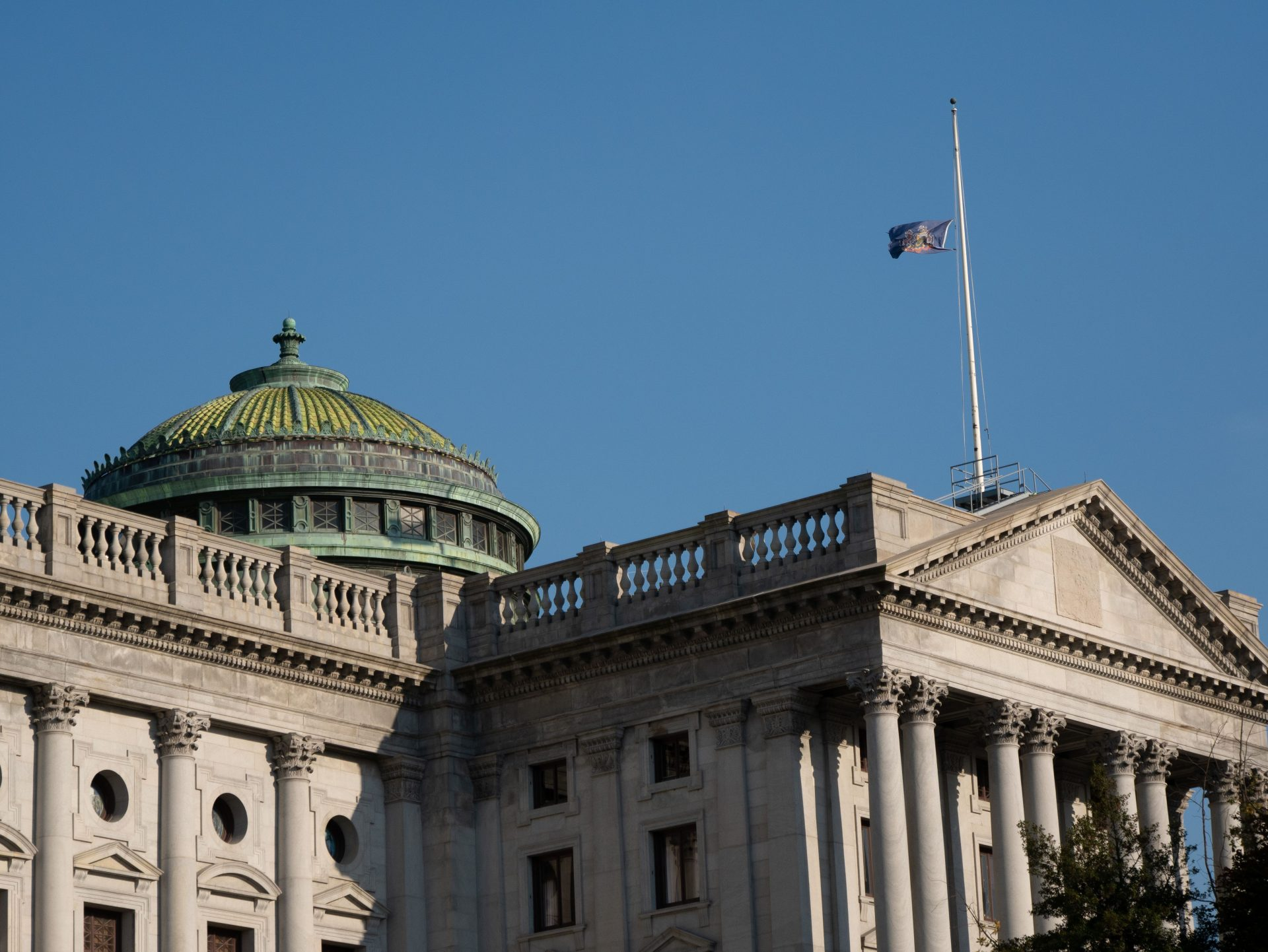 The Pennsylvania state flag flies at half-mast atop the capitol building on Oct. 31, 2018.