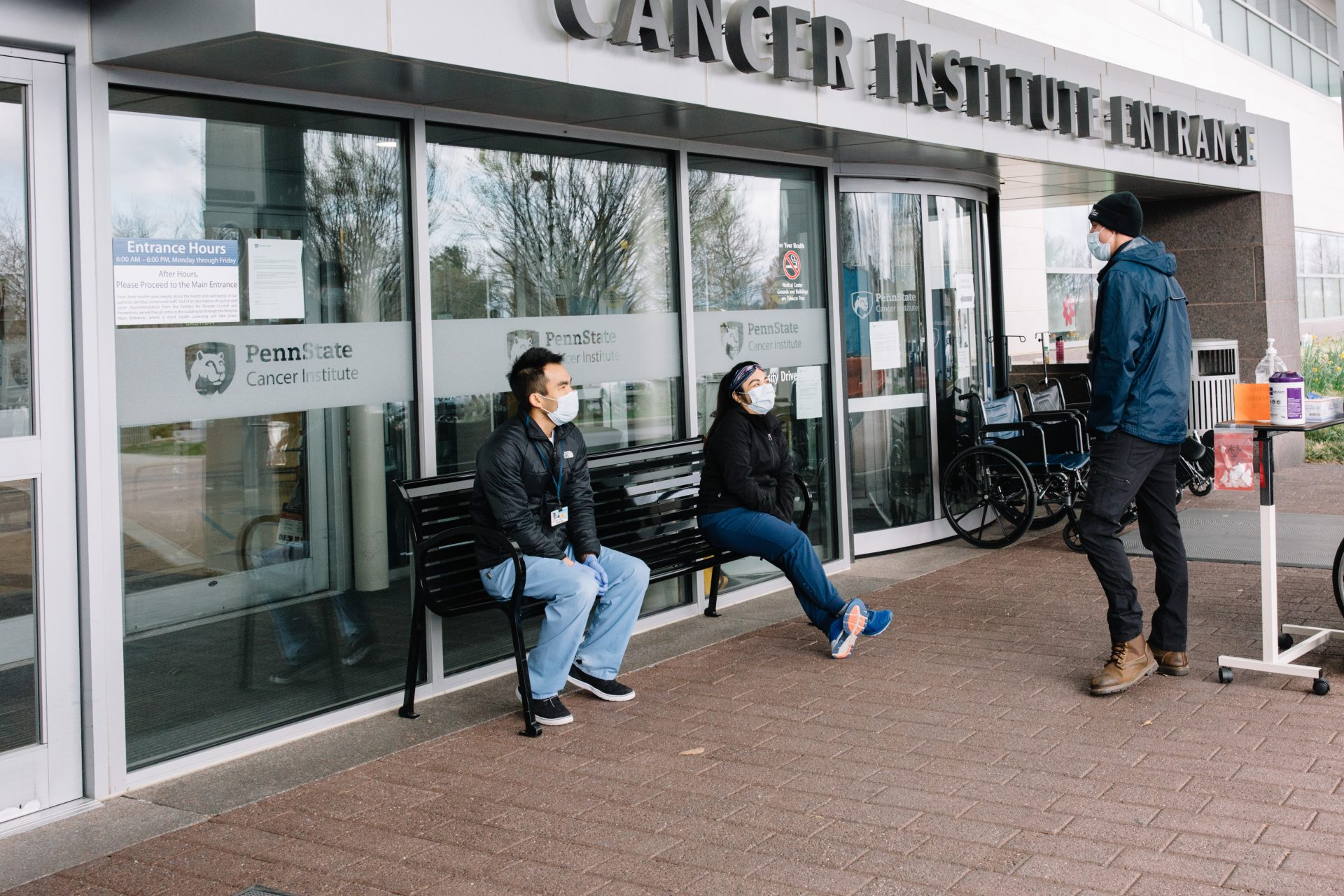 People wait outside Penn State Health's Milton S. Hershey Medical Center on April 10, 2020.