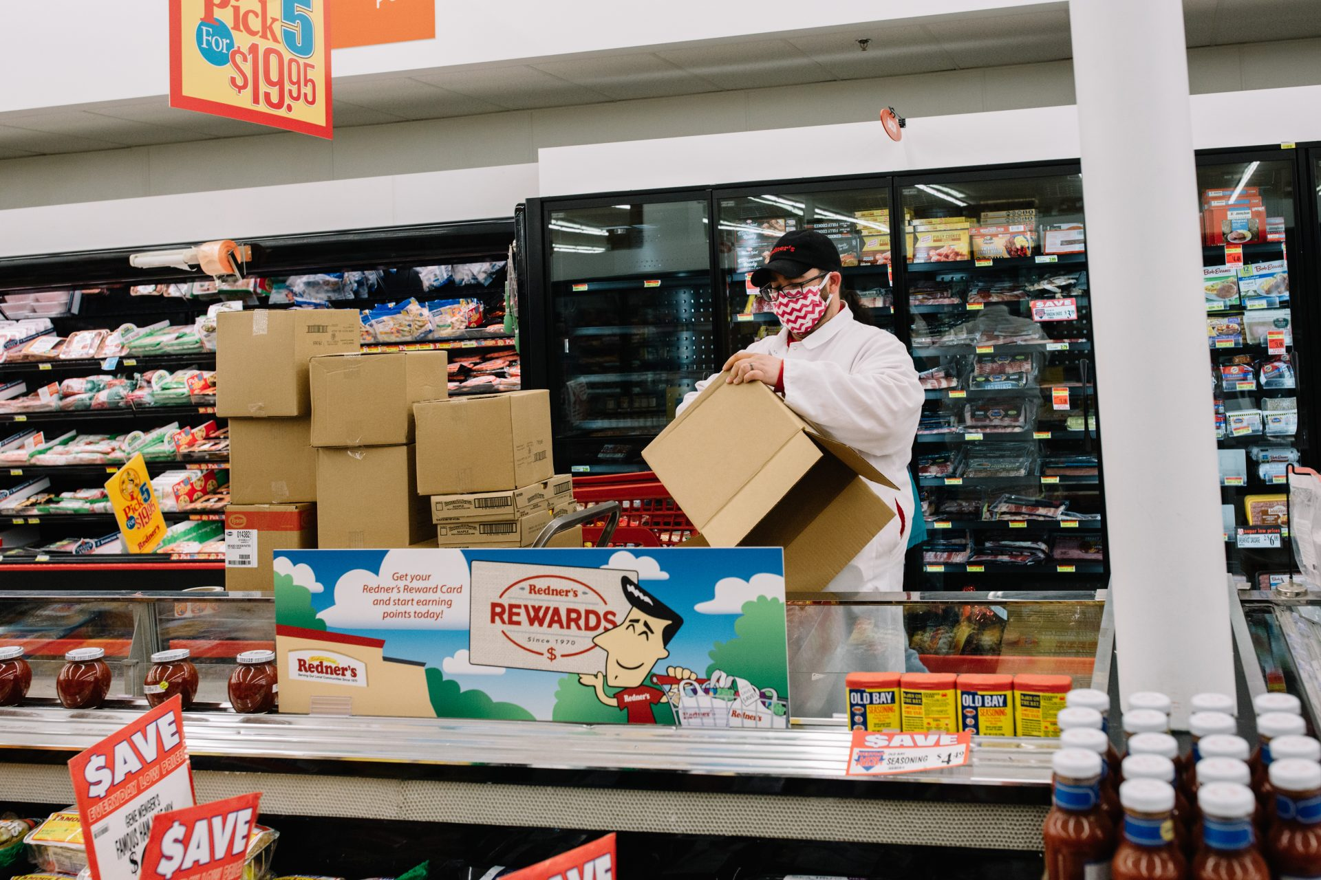 An employee unpacks boxes inside a Redner's Market.