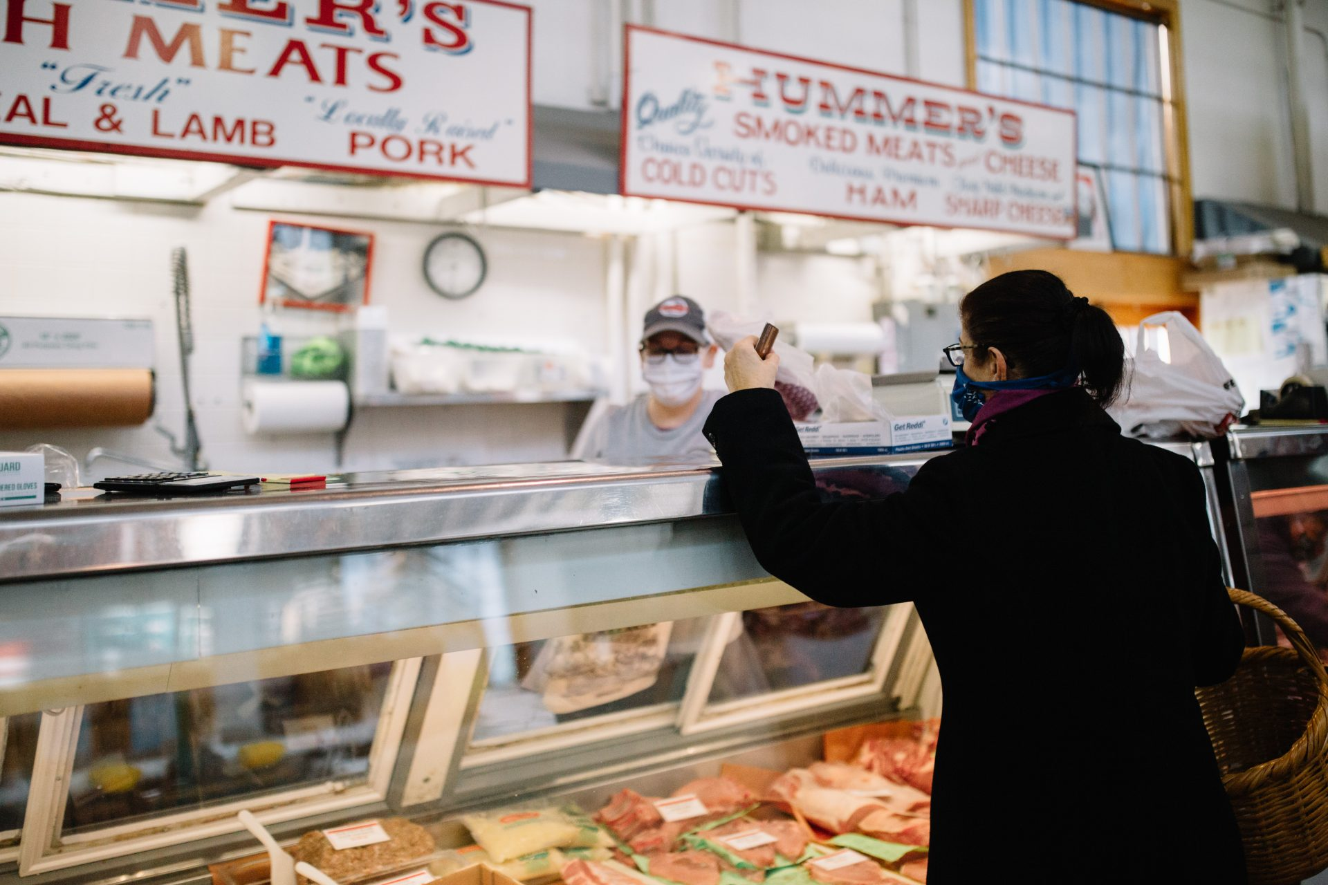 A woman purchases meat at Broad Street Market in Harrisburg on April 10, 2020. The market is much quieter since the coronavirus pandemic effectively shut down the region.