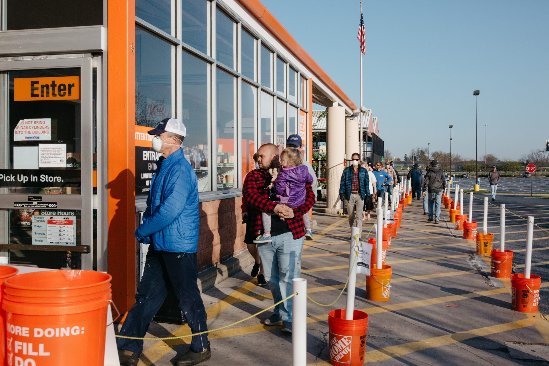 Customers line up outside a Home Depot store in Lancaster County on April 19, 2020.