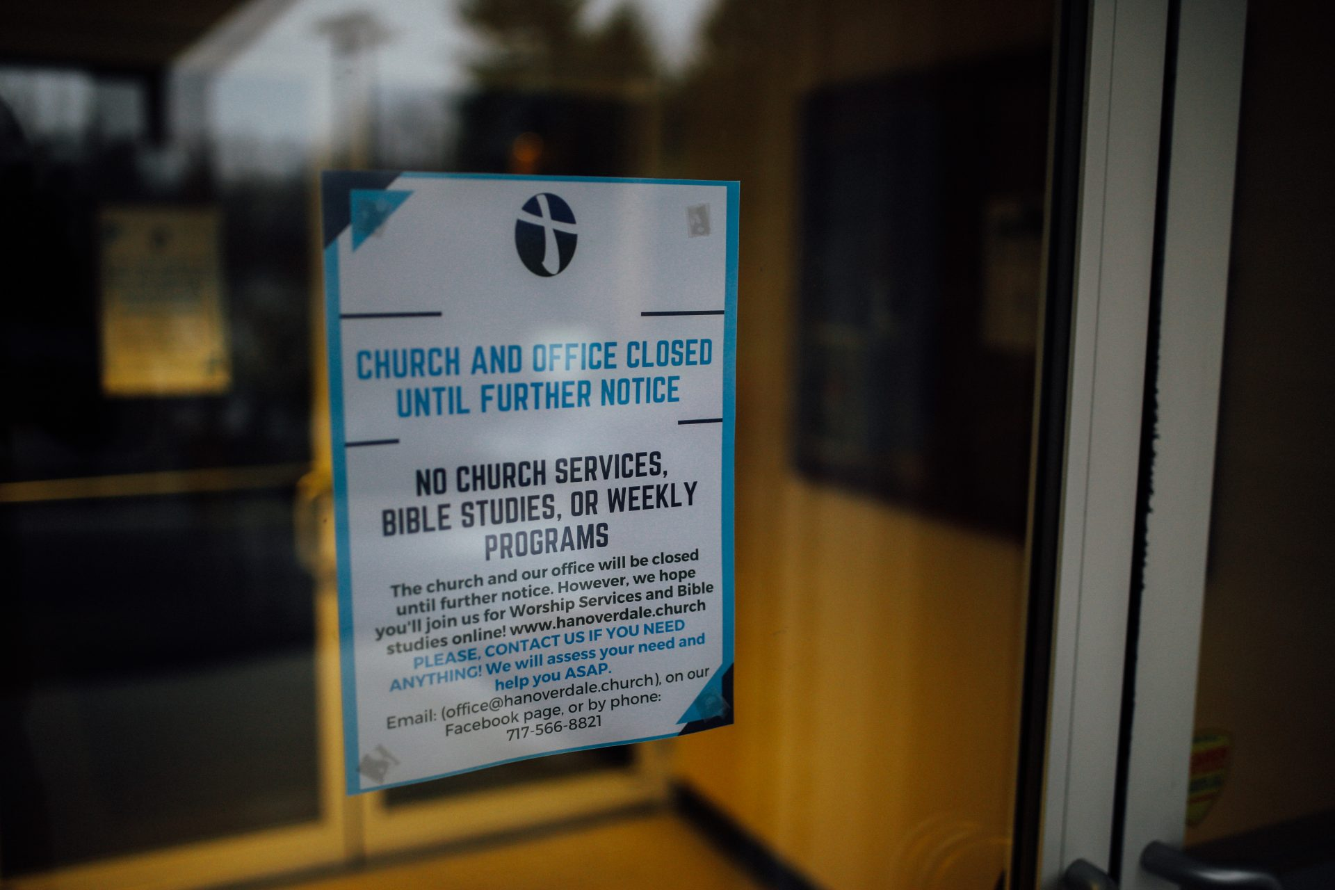 A sign on the Hanoverdale Church of The Brethren in Hummelstown, Pa., shows the church and office are closed until further notice during the coronavirus pandemic and statewide stay-at-home order.