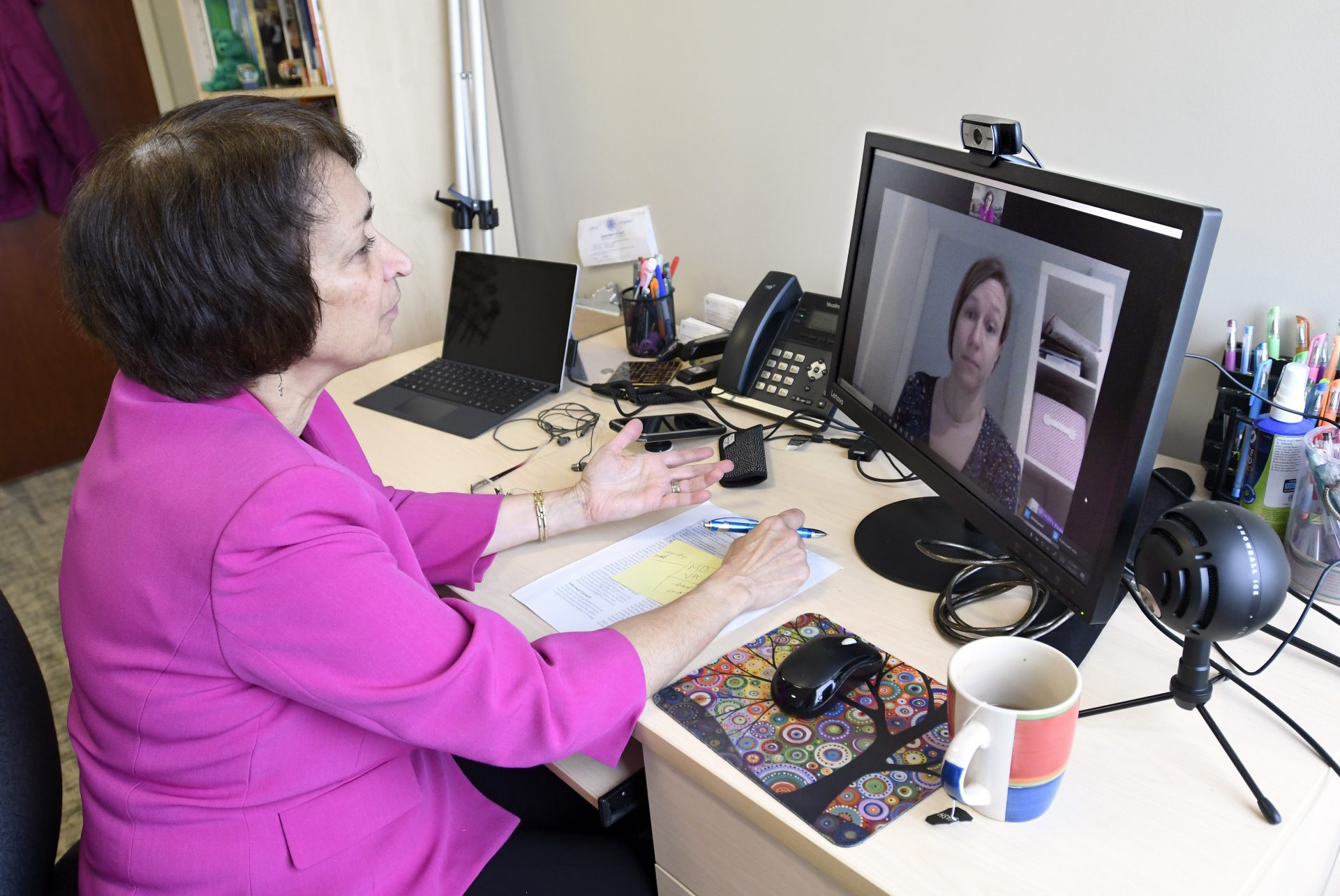 Psychologist Mary Alvord, left, holds a video conference with her colleague, psychologist Veronica Raggi, whom she had scheduled to meet in person, in Chevy Chase, Md., Wednesday, March 18, 2020. For people with anxiety disorders, the coronavirus outbreak presents a new set of worries to deal with, psychologists say.