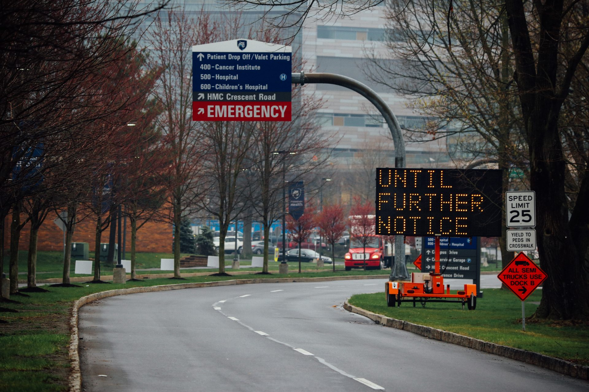 Signs at the entrance to Penn State Hershey Medical Center let drivers know visitors are not allowed inside during the coronavirus pandemic. April 1, 2020