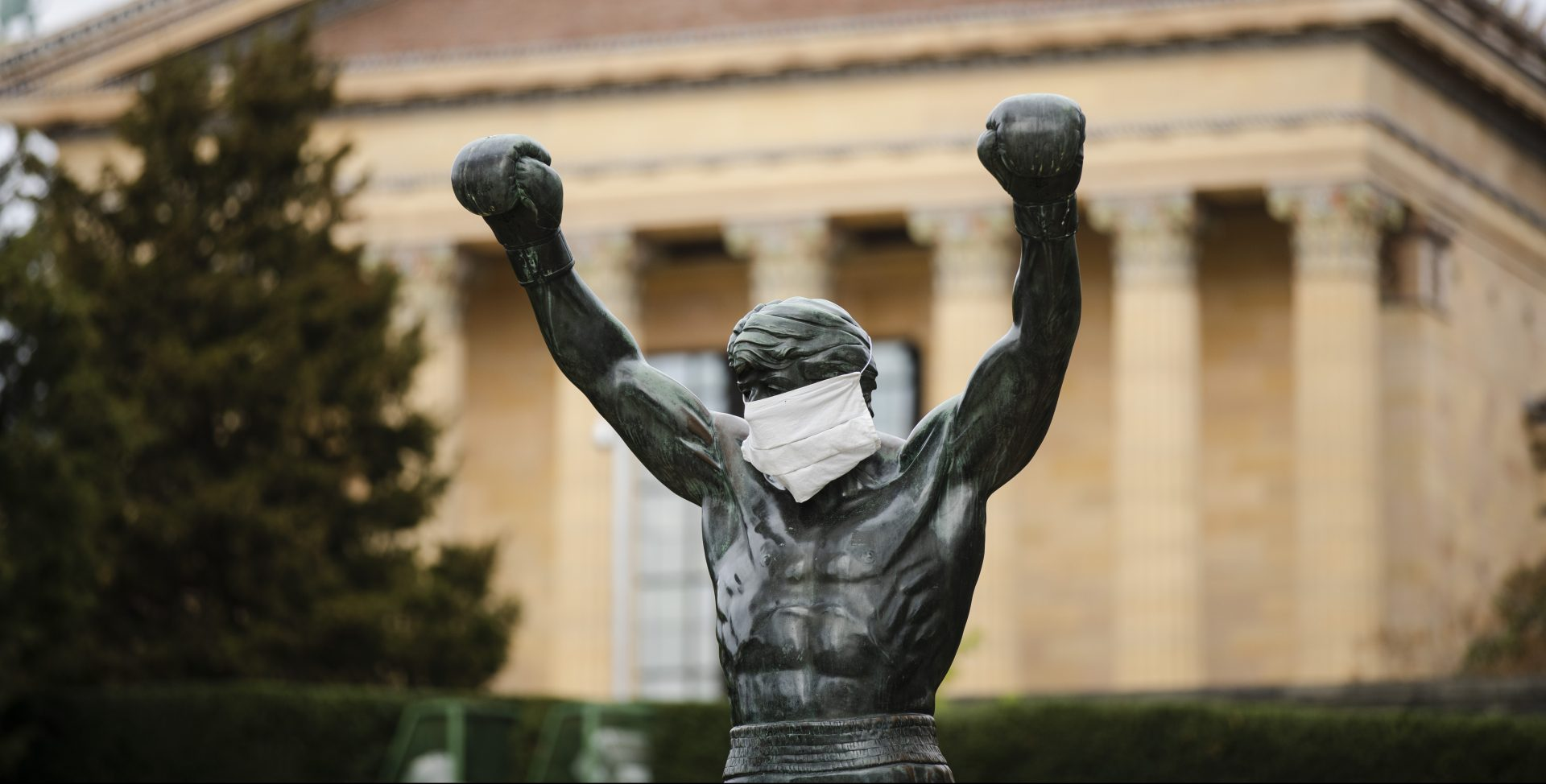 The Rocky statue is outfitted with mock surgical face mask at the Philadelphia Art Museum in Philadelphia, Tuesday, April 14, 2020.