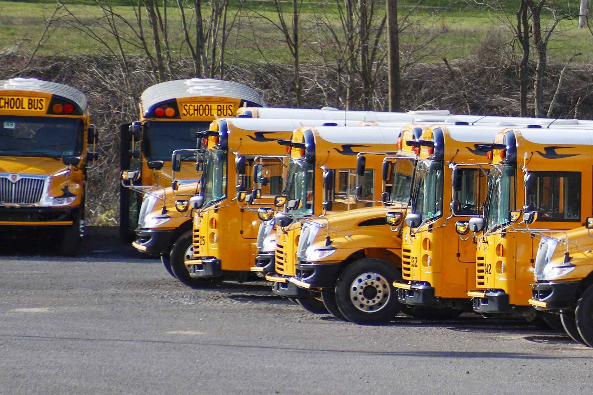 School buses are parked at a depot Thursday, April 9, 2020, in Zelienople, Pa. Pennsylvania Gov. Tom Wolf said Thursday that schools will remain shuttered for the rest of the academic year because of the coronavirus pandemic.
