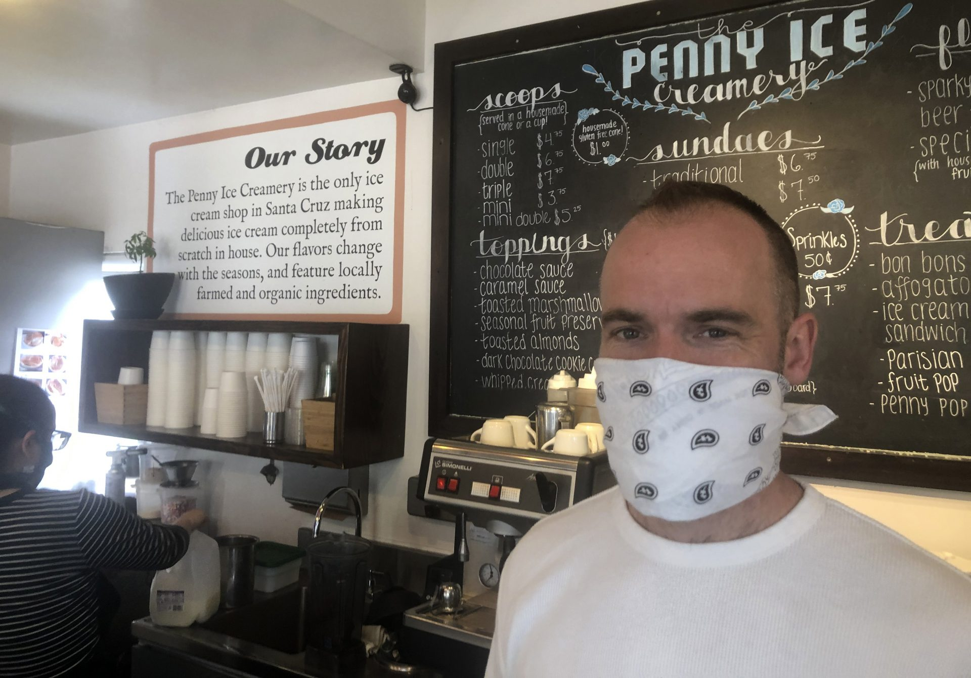 "In this April 17, 2020, photo, Zachary Davis poses for a photo at The Penny Ice Creamery in Santa Cruz, Calif. An investigation by The Associated Press hows that many large companies which collectively received tens of millions of dollars in federal loans through the Paycheck Protection Program were at risk of failing even before the coronavirus walloped the economy, while others have acknowledged problems keeping their finances straight and a few have been under investigation by the Securities and Exchange Commission. That big companies and ones with questionable records received such precious financial aid during the chaotic last few weeks frustrates Davis, ""We were feeling pretty good about where we were in the world. Now it's just all turned upside down,"" said Davis, who had to lay off 70 workers."