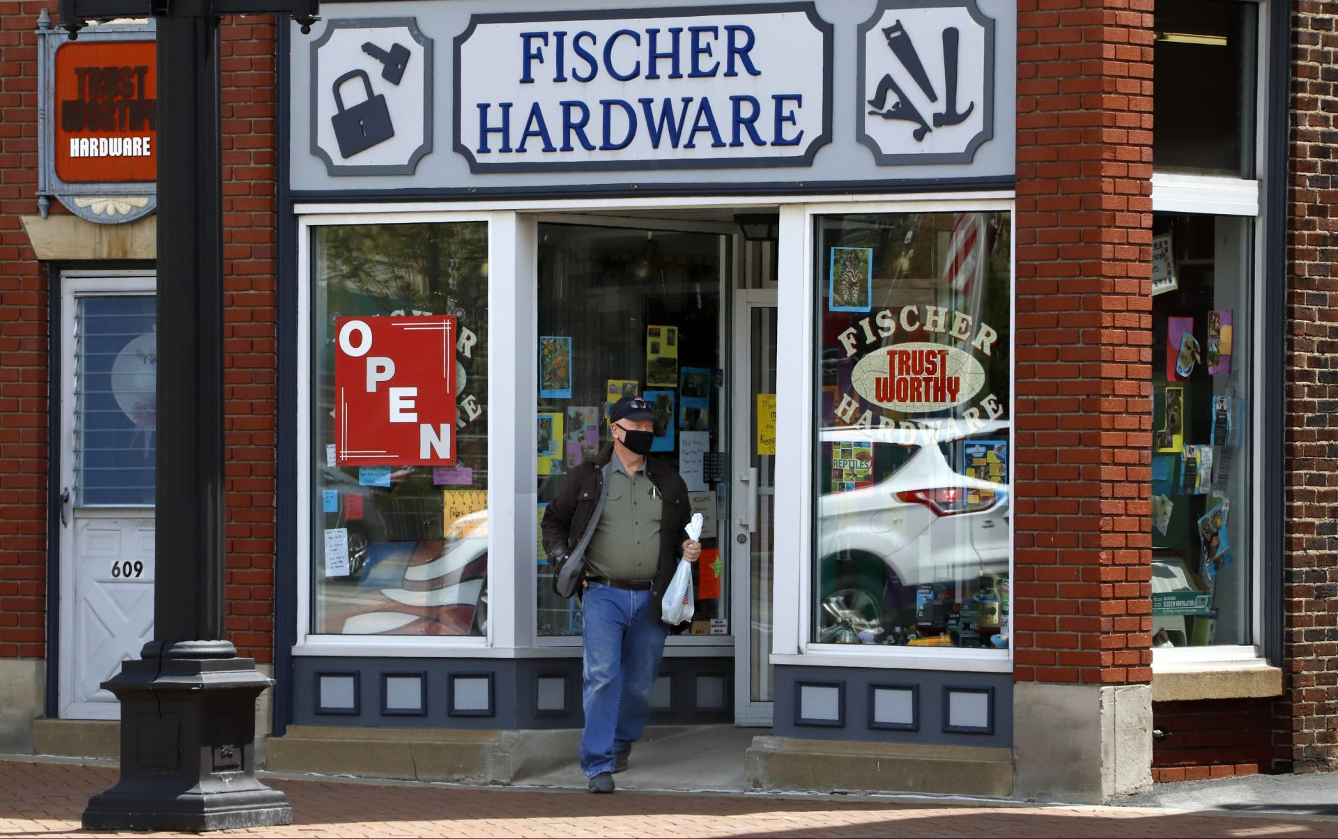 """A customer exits Fischer Hardware in Beaver, Pa., Tuesday, May 12, 2020. Beaver County Commissioners have said they disagree with Pennsylvania Governor Tom Wolf and the county will act as if they are transitioning to the """"yellow"""" phase on May 15. Pennsylvania Governor Tom Wolf announced, May 8, that 13 southwestern Pennsylvania counties, not including Beaver County, that would remain in the """"red"""" phase where the stay-at-home order is still in effect, would move to the """"yellow"""" phase on May 15."""