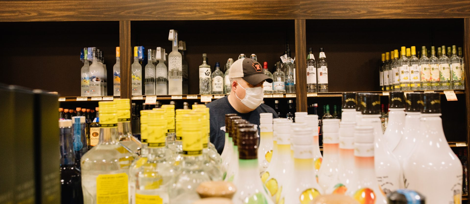 A customer wears a mask while shopping at a Fine Wine and Good Spirits store in Cumberland County on May 22, 2020, the first day the store reopened to shoppers after having been closed due to the coroanvirus.