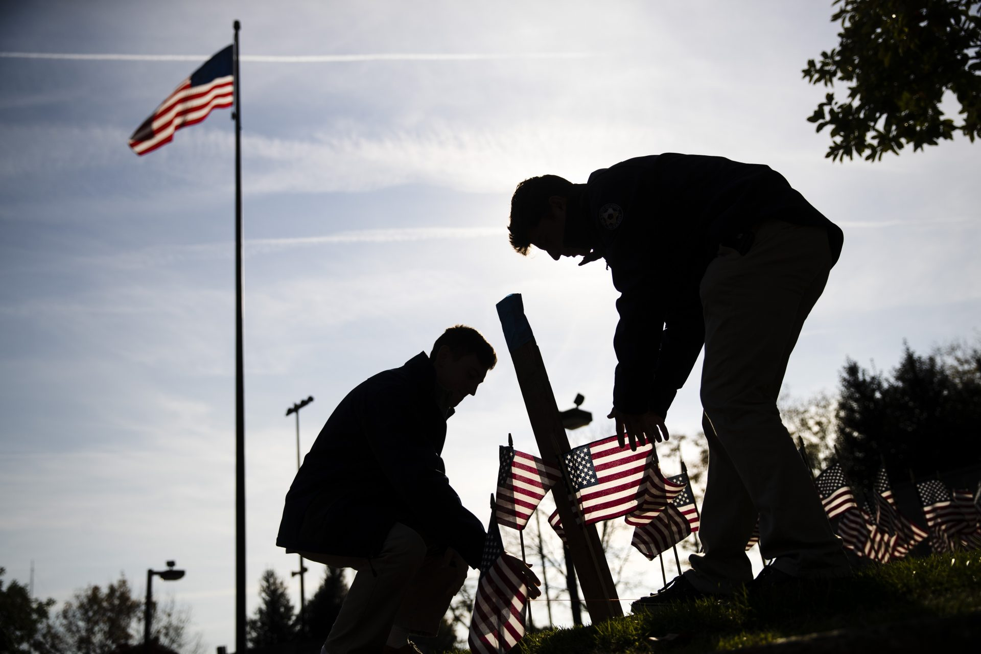 American flags are posted in the ground ahead of a Veterans Day ceremony at the Vietnam War Memorial in Philadelphia, Monday, Nov. 11, 2019.