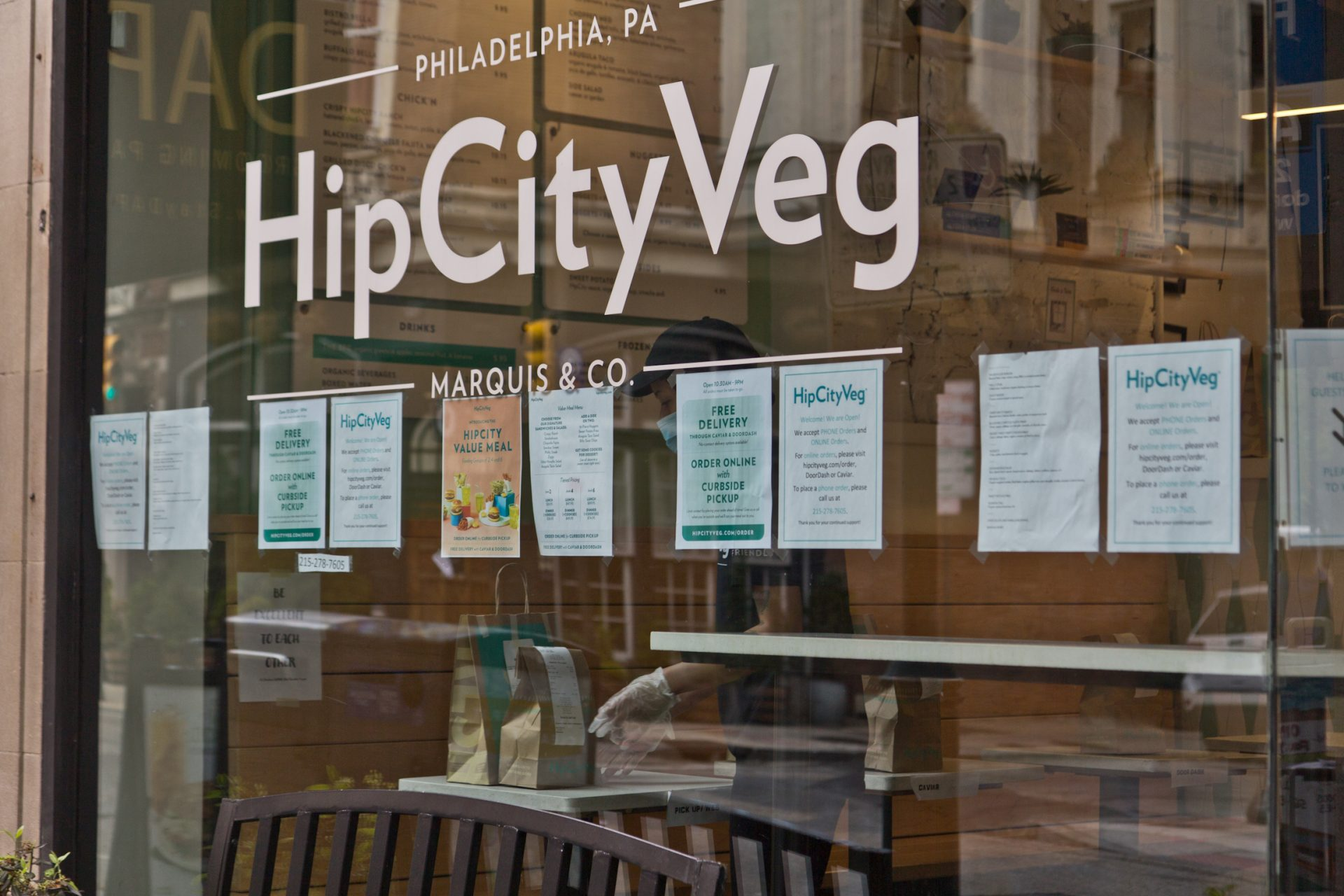Hip City Veg employees prepare to-go orders in Center City.