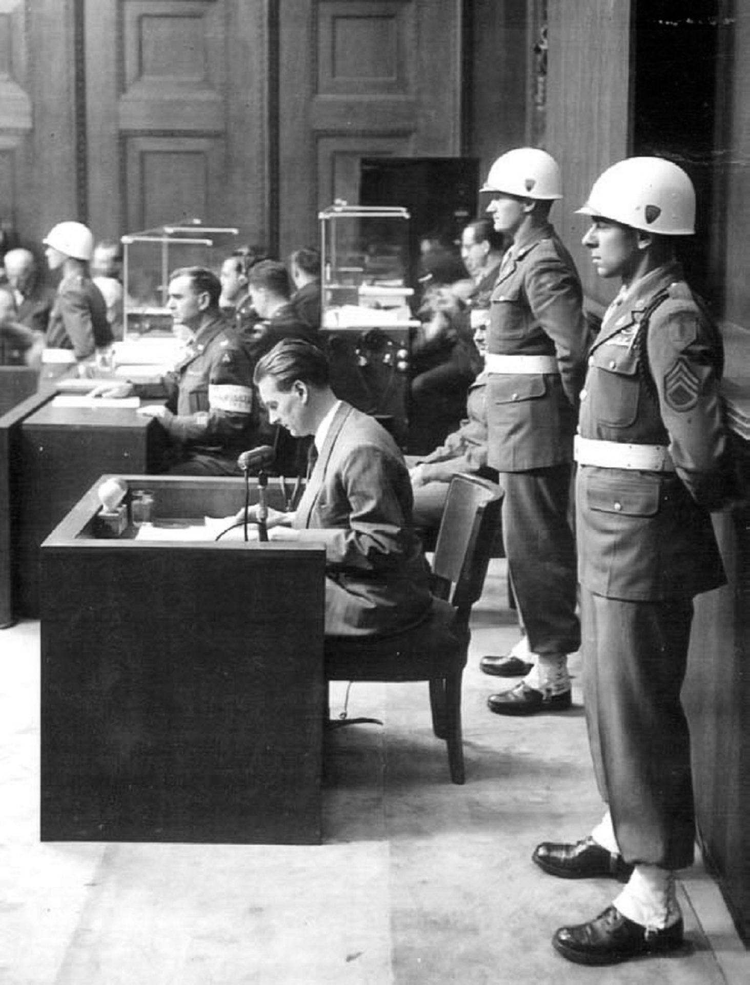 Staff Sgt. Emilio DiPalma (right) stands on guard at the Nuremberg Trials in 1945.
