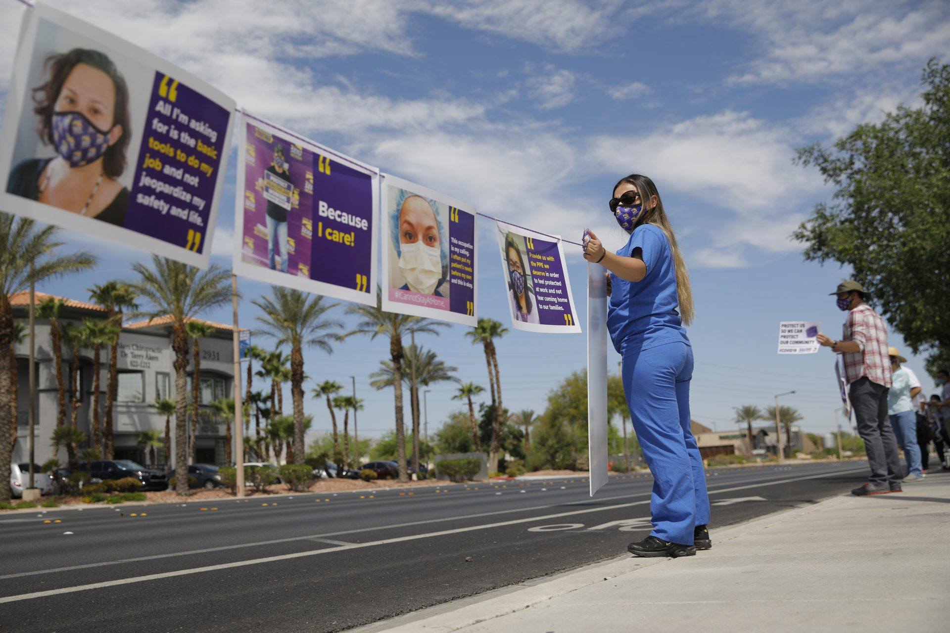 A registered nurse, who declined to give her full name, protests outside of MountainView hospital Thursday, April 30, 2020, in Las Vegas. Healthcare workers protested what they say are unsafe working conditions and demand OSHA to intervene