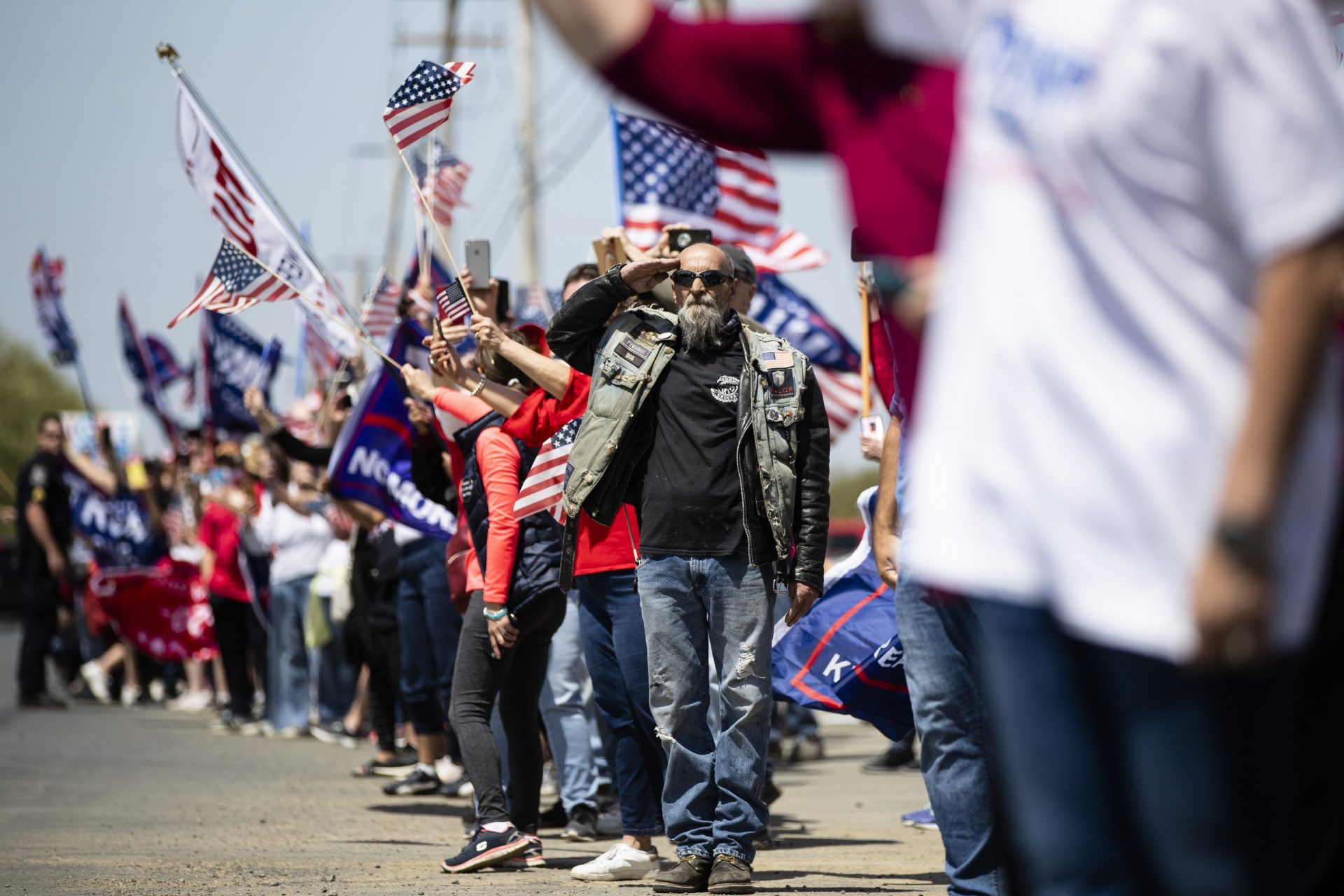 A man salutes as President Donald Trump's motorcade drives past on Thursday, May 14, 2020, in Allentown, Pa.