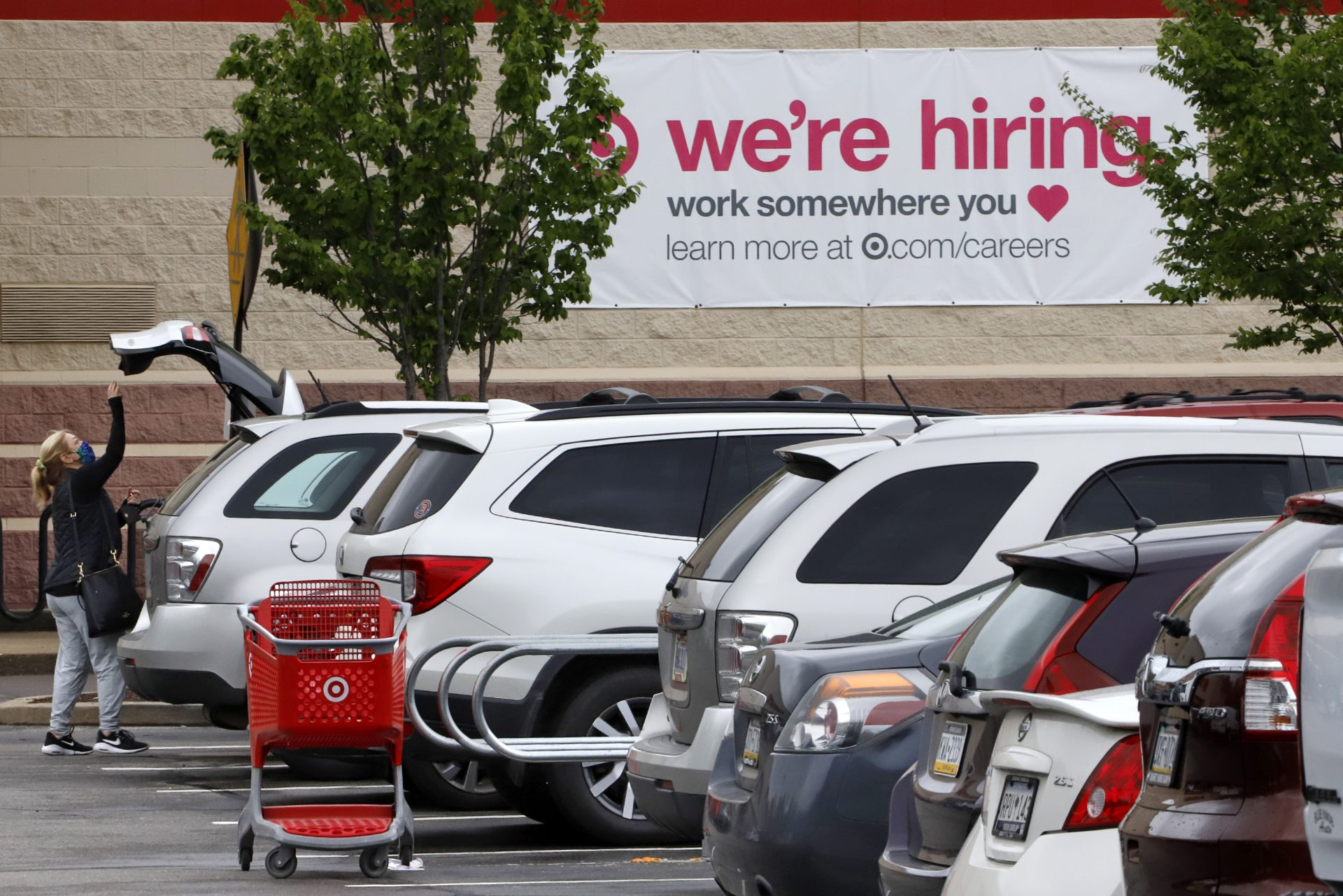 A shopper loads her car after shopping at a Target store in Robinson Township, Pa., Wednesday, May 6, 2020.
