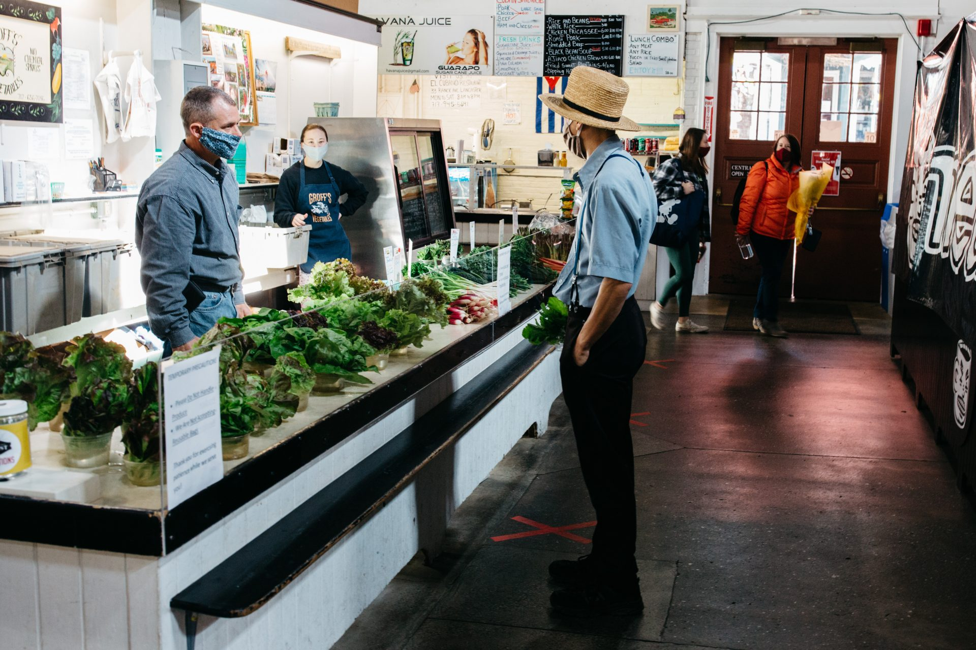Vendors and shoppers don masks while at Lancaster Central Market on May 9, 2020.