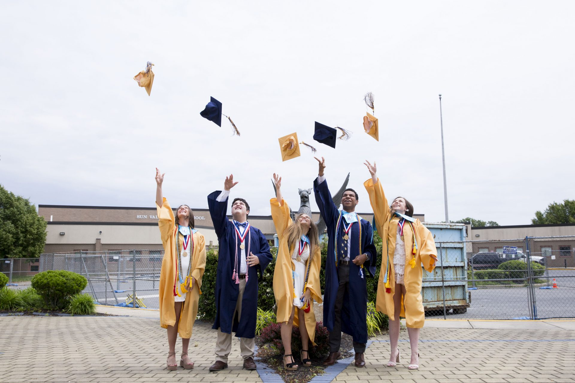 Bryson Eldrige (second to right), Sun Valley senior class president, throws his graduation cap with Sun Valley class officers (from left) Shay Buck, Dominick Marano, Sophia Belgirono, and Holly Dan after the class put together a virtual commencement ceremony on June 2, 2020.