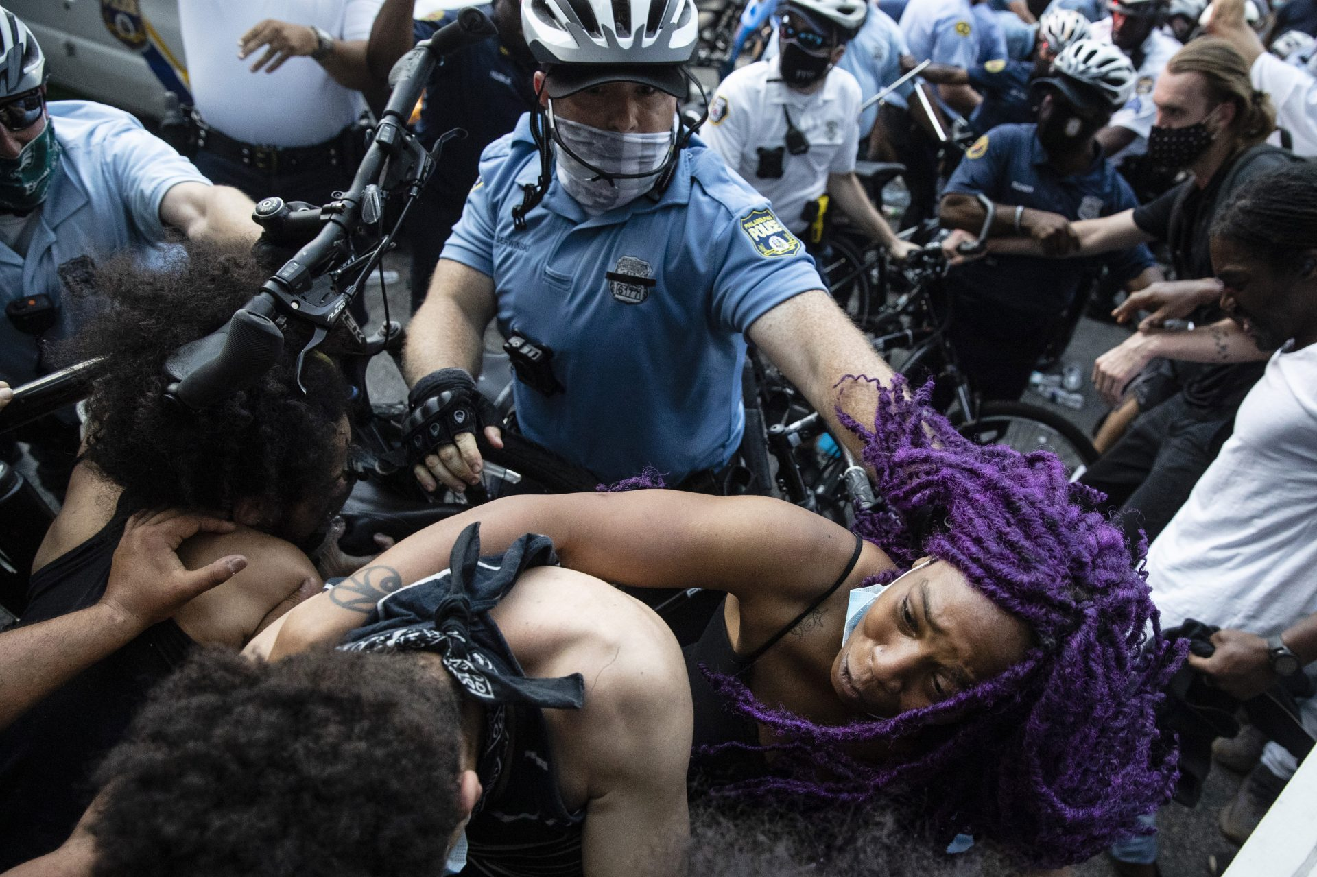Police and protesters clash Saturday, May 30, 2020, in Philadelphia, during a demonstration over the death of George Floyd, a black man who was in police custody in Minneapolis. Floyd died after being restrained by Minneapolis police officers on Memorial Day.