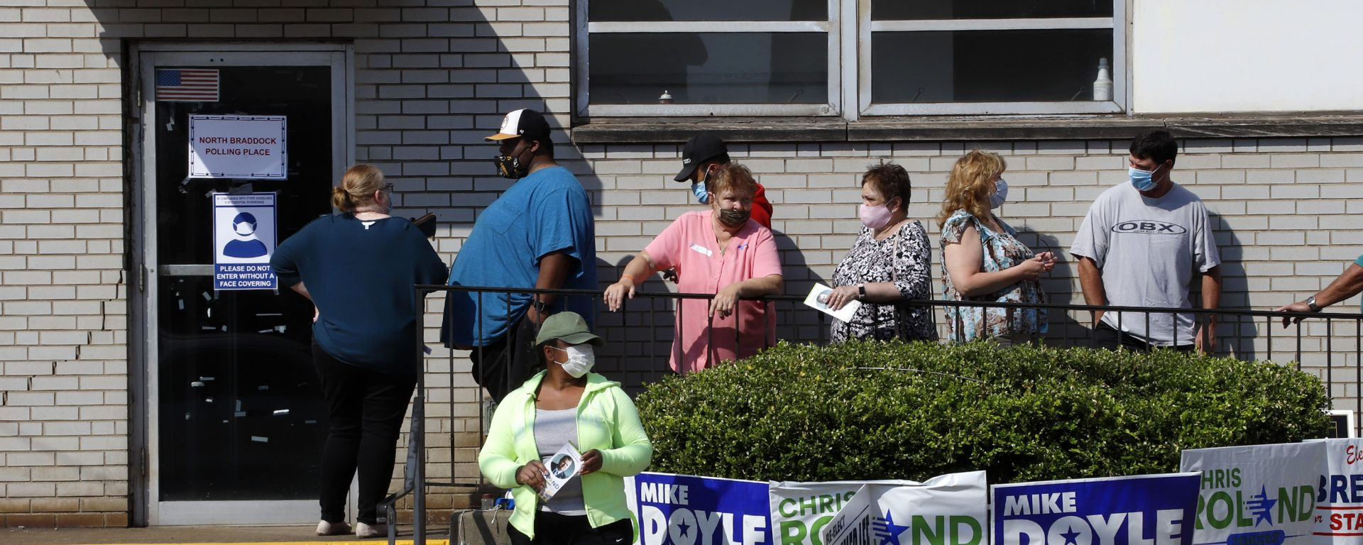 Voters wait in line to vote in the Pennsylvania Primary outside the North Braddock Municipal Building in Braddock, Pa., Tuesday, June 2, 2020.