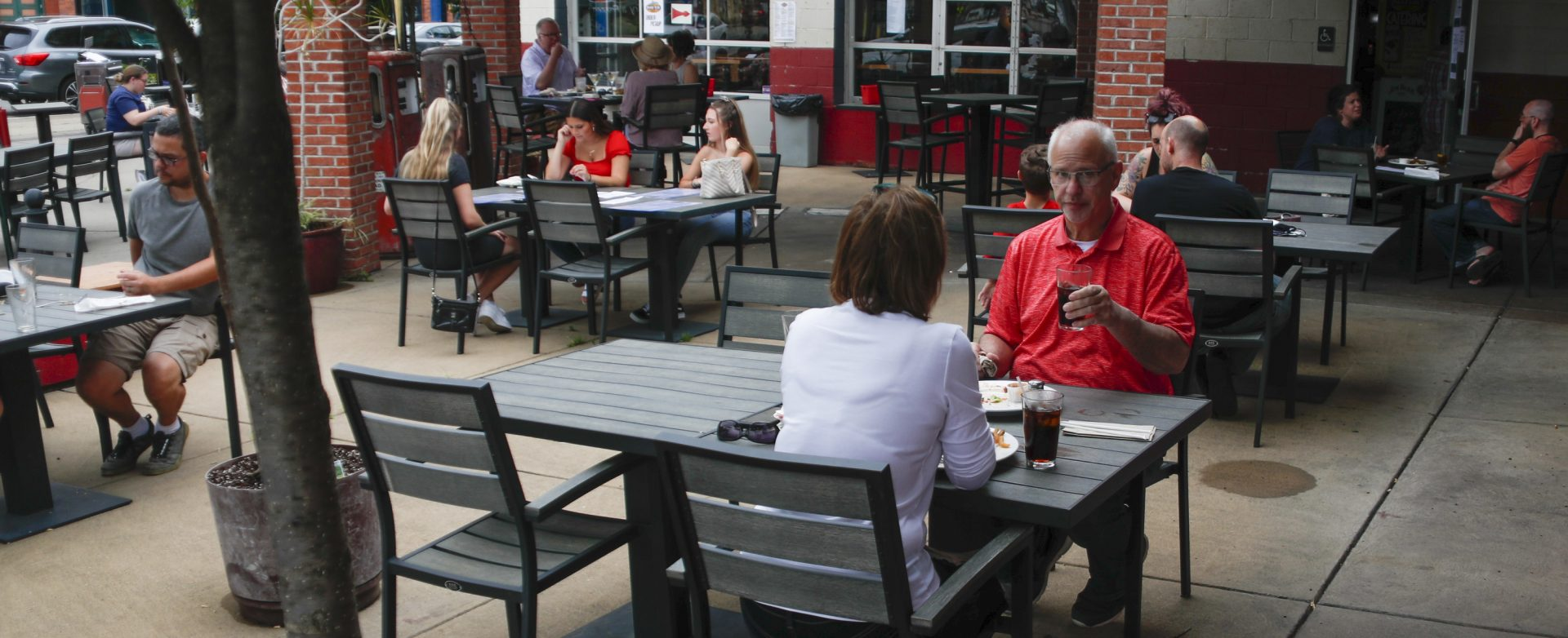 People take advantage of newly lowered COVID-19 protective restrictions in most of southwest Pennsylvania and have lunch outside on the re-opening day for seated patrons at a diner on Pittsburgh's Southside, Friday, June 5, 2020.
