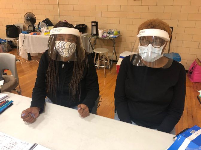 Poll workers at the 1st Ward/1st precinct in Harrisburg, Pa. wear face masks and shields to protect them against coronavirus during voting in the June 2, 2020, primary election.