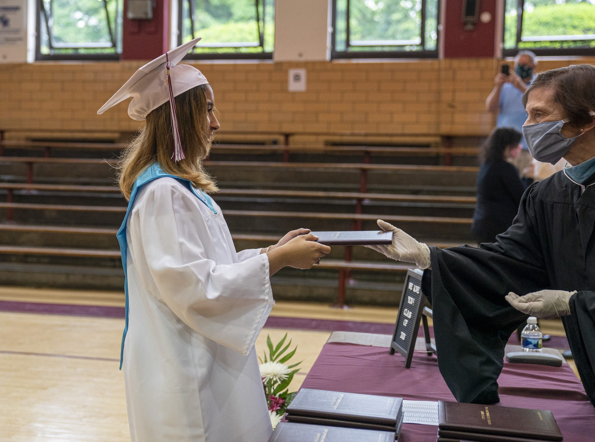 Ashley receives her diploma on graduation day at Little Flower Catholic School for Girls in Hunting Park.