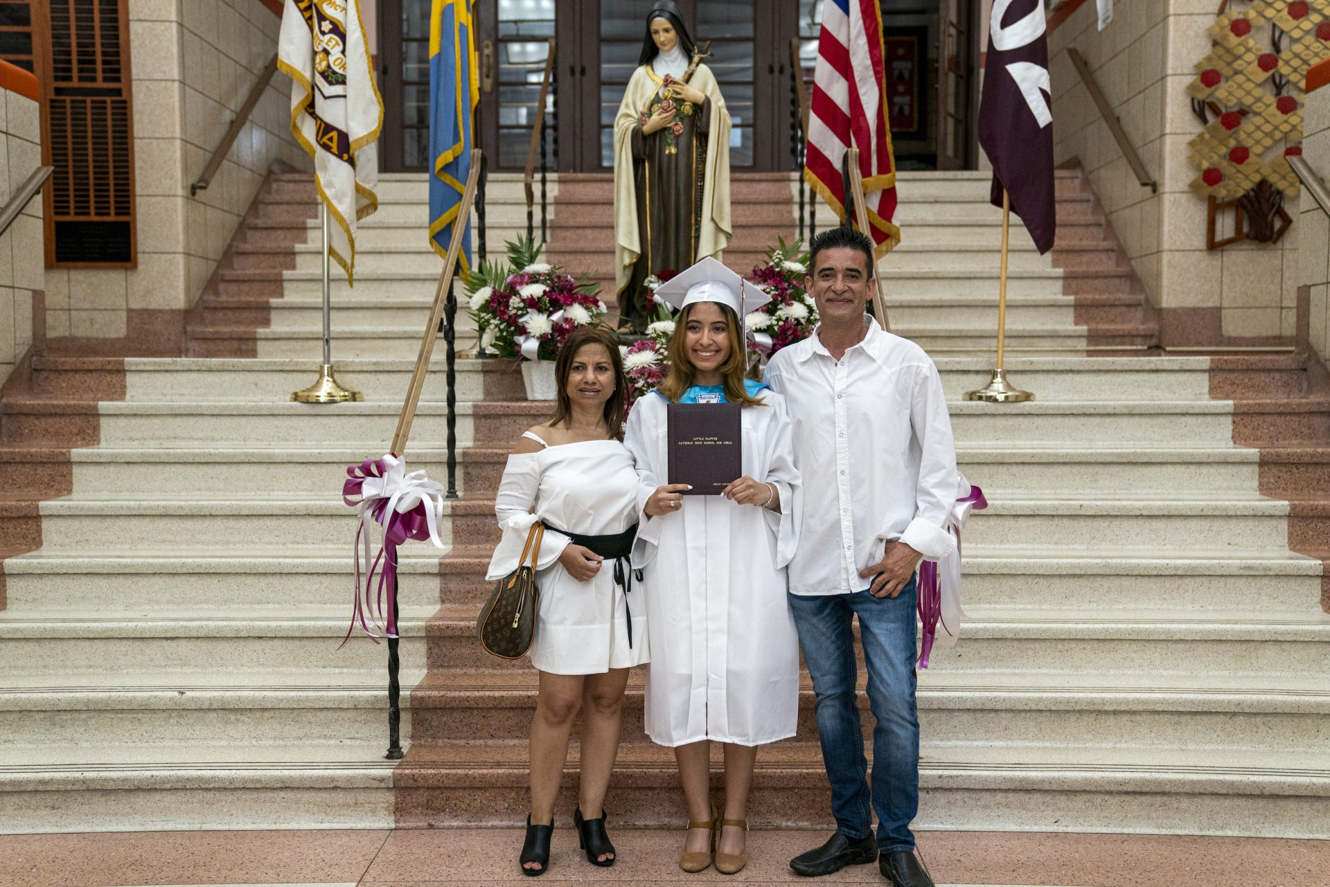 Ashley Acevedo with her parents Elena and Johnny on graduation day inside Little Flower Catholic School for Girls.