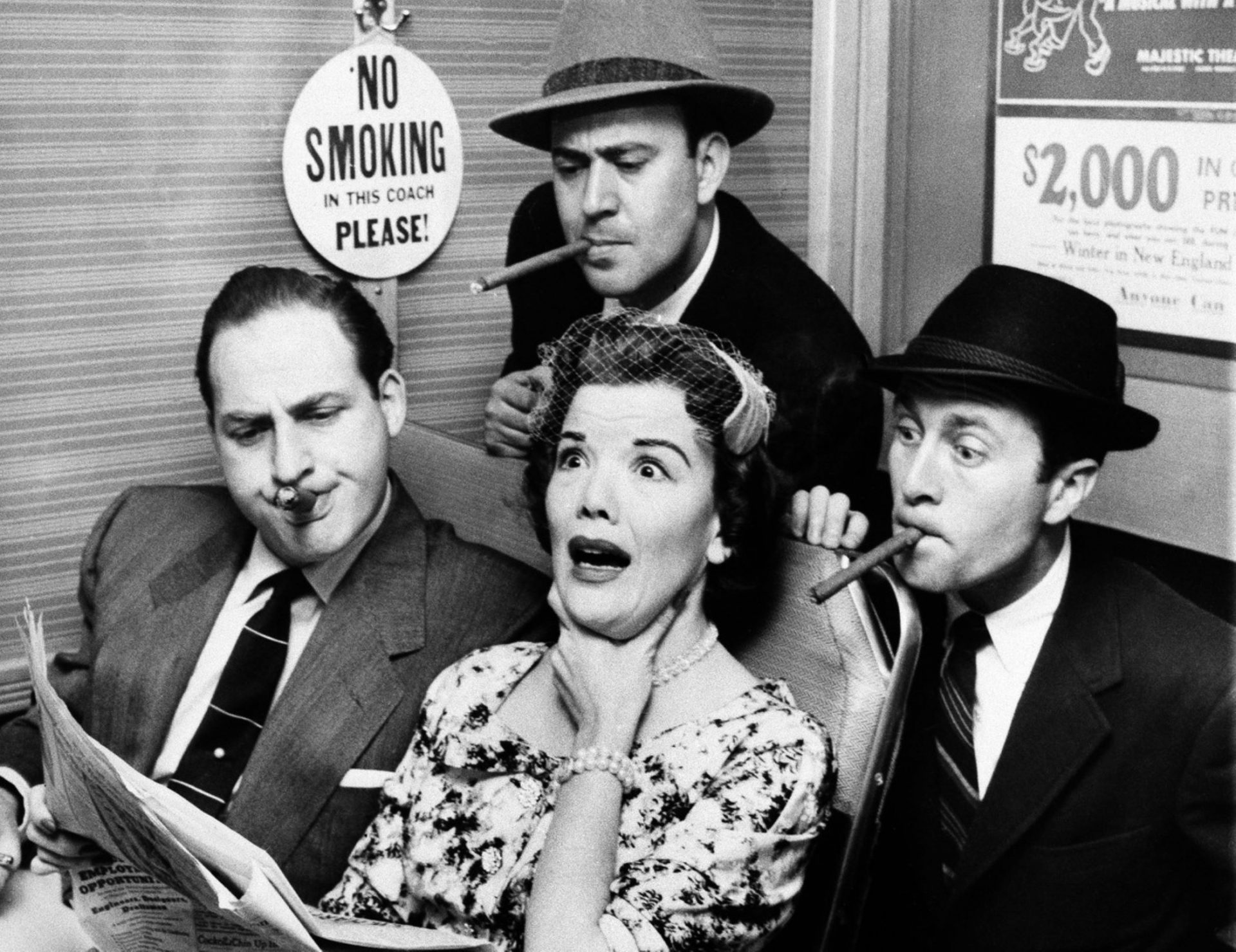 Reiner, top center, Sid Caesar, left, and Howard Morris, right, bother railroad commuter Nanette Fabray on an episode of the sketch comedy show Caesar's Hour in 1955.