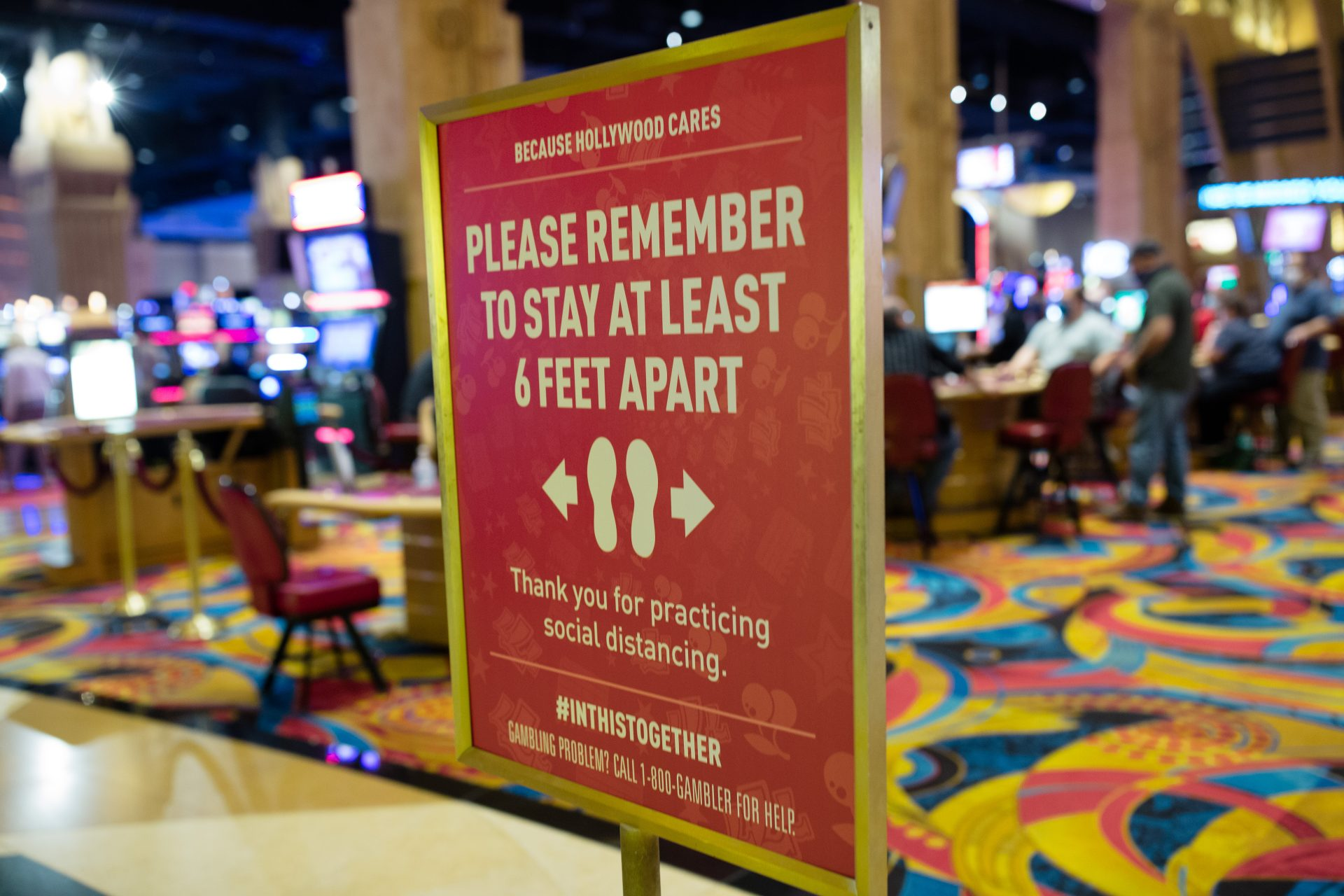 A sign directs patrons to maintain their distance at Hollywood Casino in Grantville on Friday, June 19, 2020.