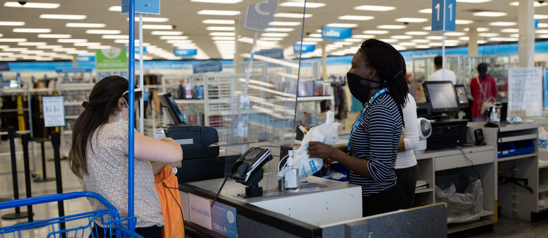 A cashier and customer interact while wearing masks inside the Ross store on Jonestown Road in Harrisburg on Friday, June 19, 2020.