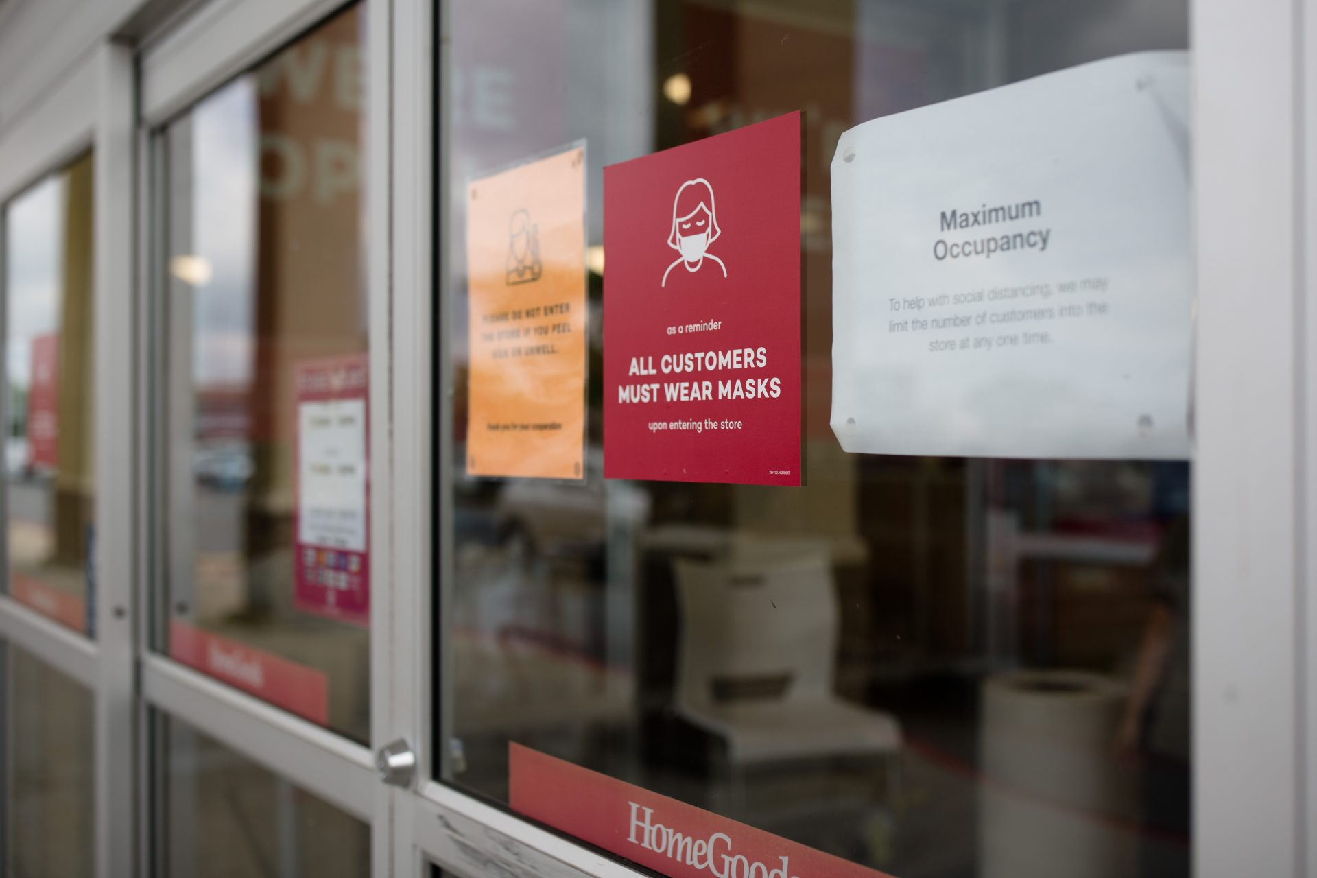 Signs directing customers to wear masks and stating occupancy limits are posted on the door of Home Goods store on Jonestown Road in Harrisburg on Friday, June 19, 2020.