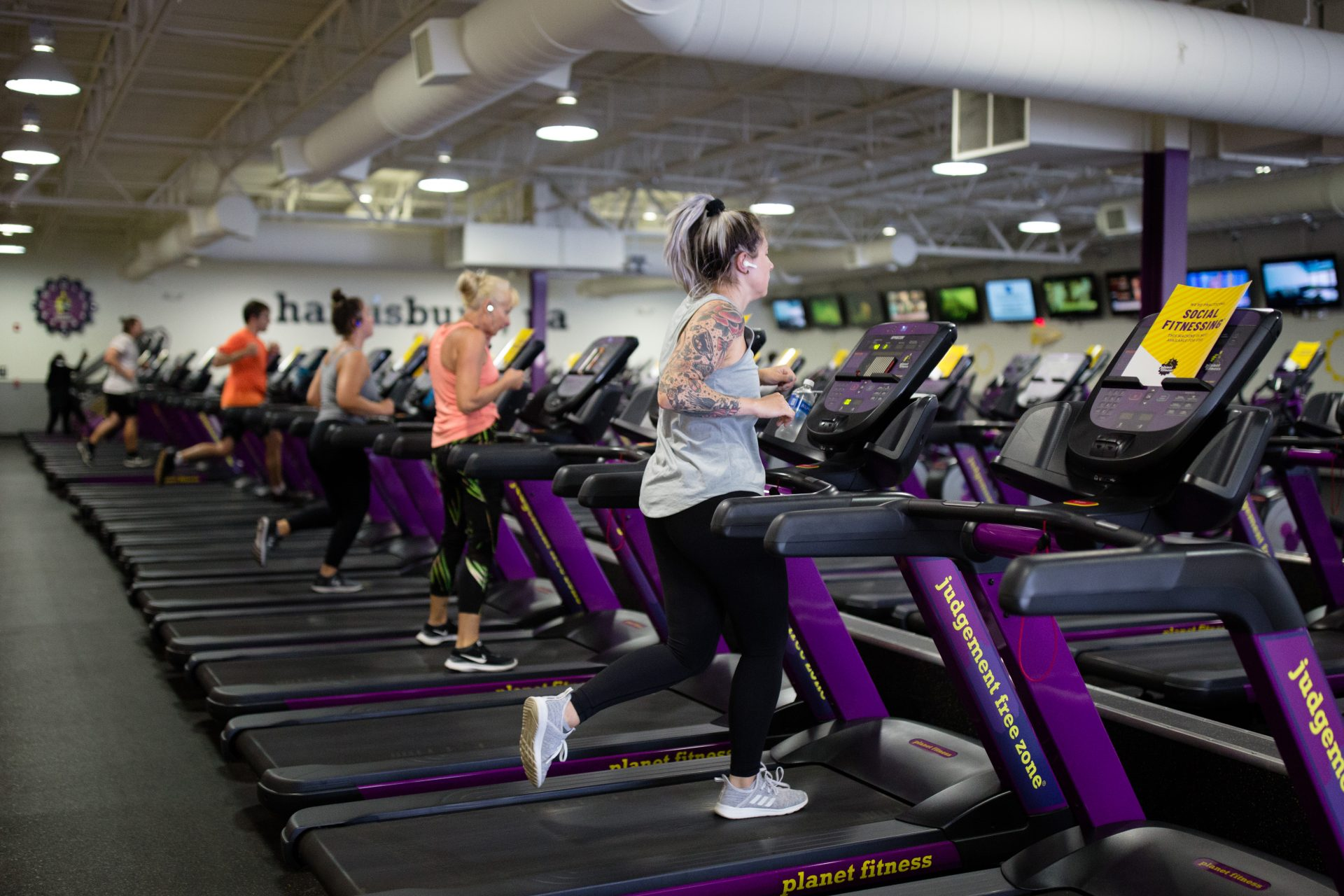 People exercise on treadmills at the Planet Fitness along Allentown Boulevard in Harrisburg on June 19, 2020. As the gym reopened to customers, it blocked off half the treadmills to maintain distance between patrons.