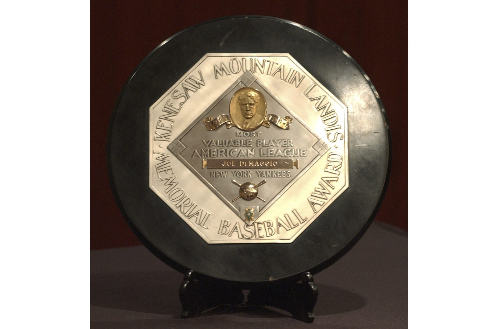 FILE - In this Jan. 22, 2006, file photo,a Joe DiMaggio 1947 MVP Award Plaque is displayed at a news conference in New York. The plaque features the name and image of Kenesaw Mountain Landis.