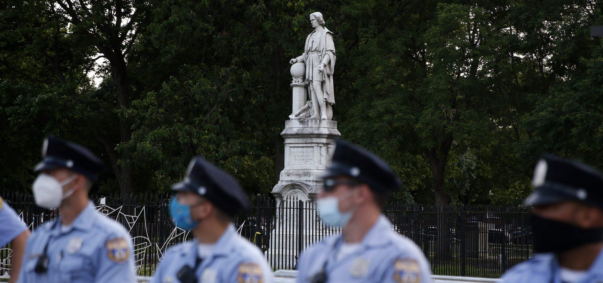Philadelphia police officers gather near the statue of Christopher Columbus at Marconi Plaza, Monday, June 15, 2020, in the South Philadelphia neighborhood of Philadelphia.