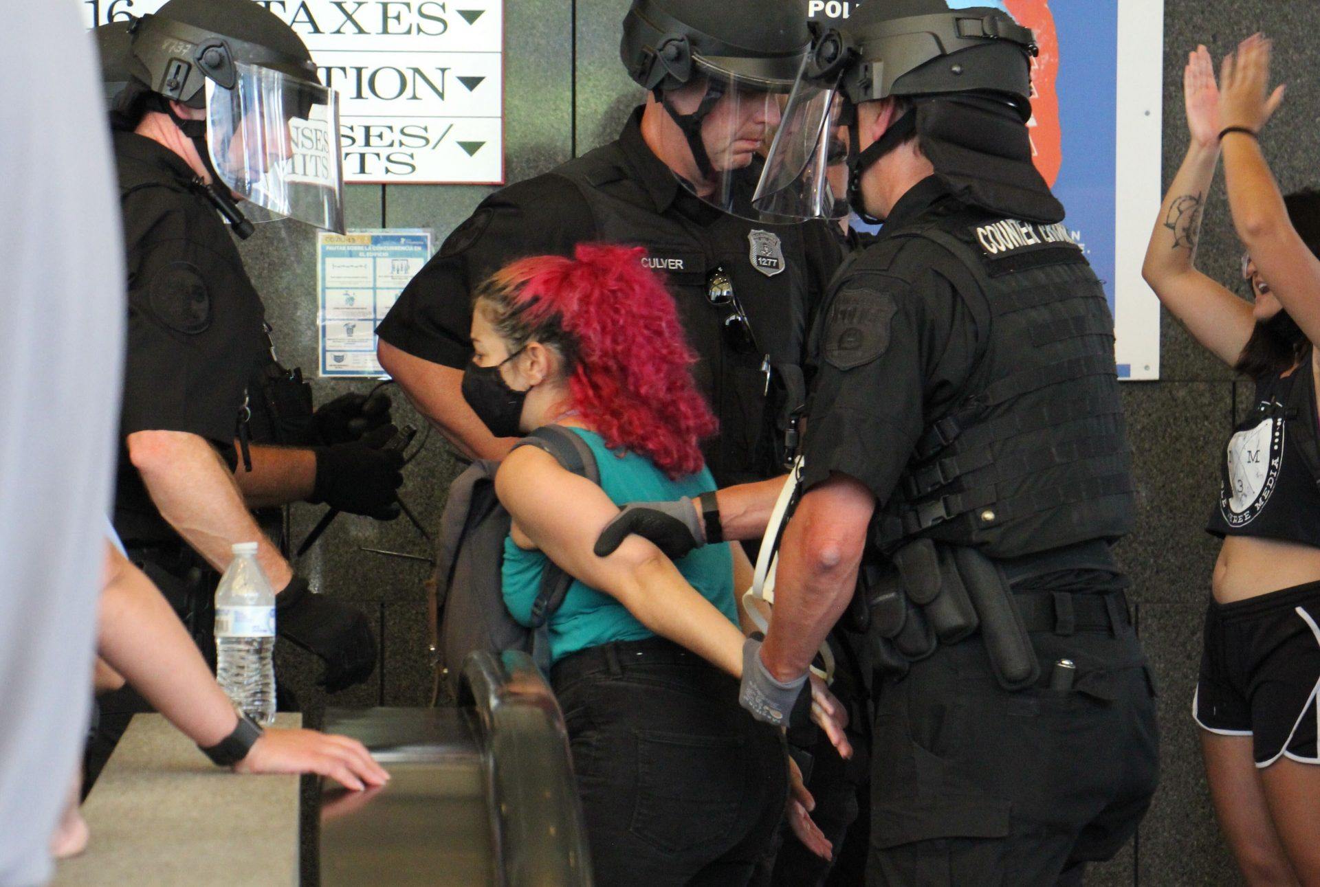Philadelphia police arrest protesters inside the Municipal Services Building.