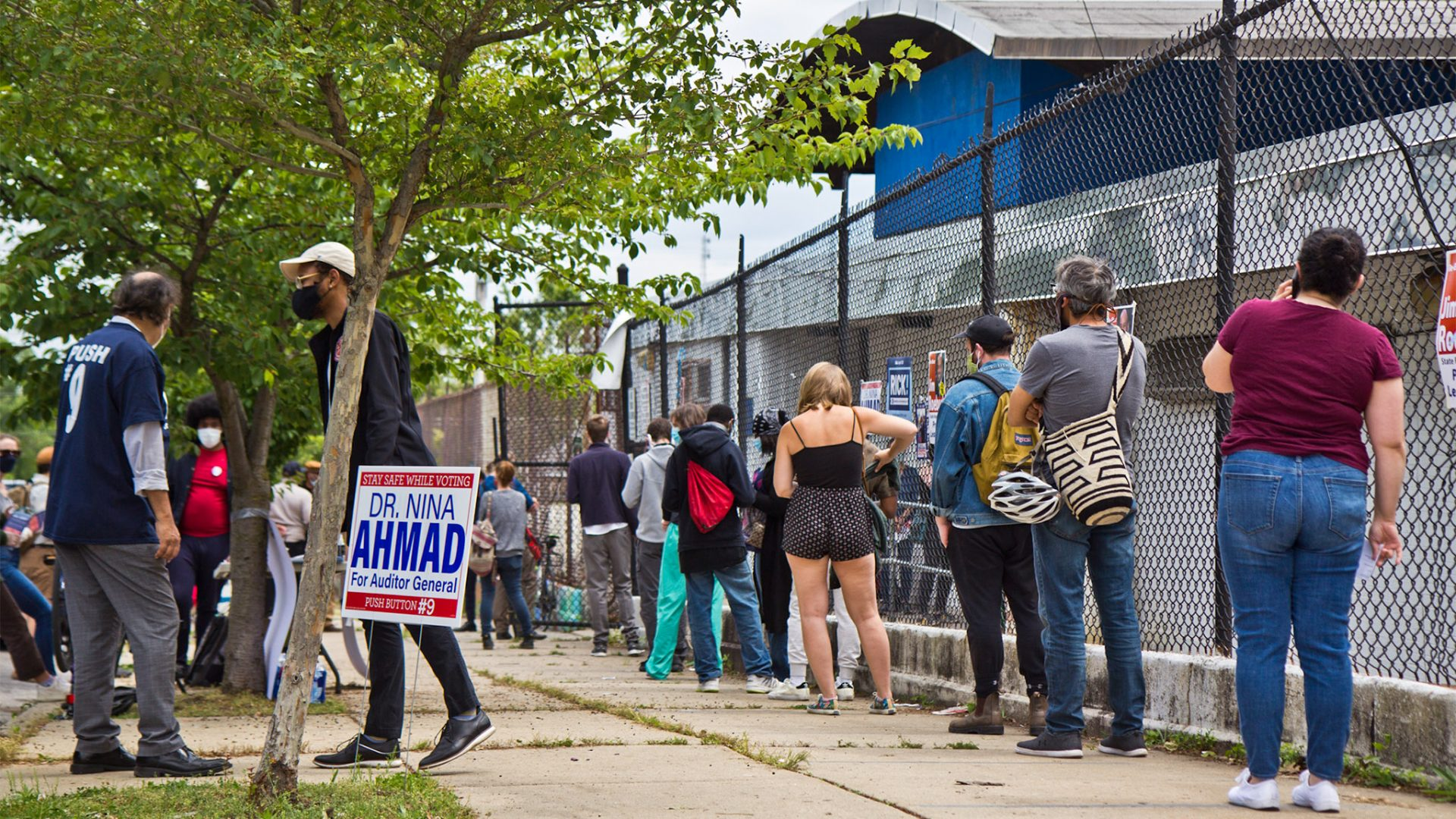 Voters wait in a socially distanced line outside their polling place in Philadelphia.