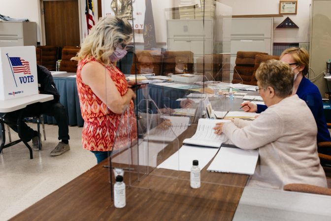 A voter checks in at the Mount Joy Borough Municipal Office on June 2, 2020. Many polling places were equipped with plexiglass screens to minimize the chance of spreading coronavirus between poll workers and voters.