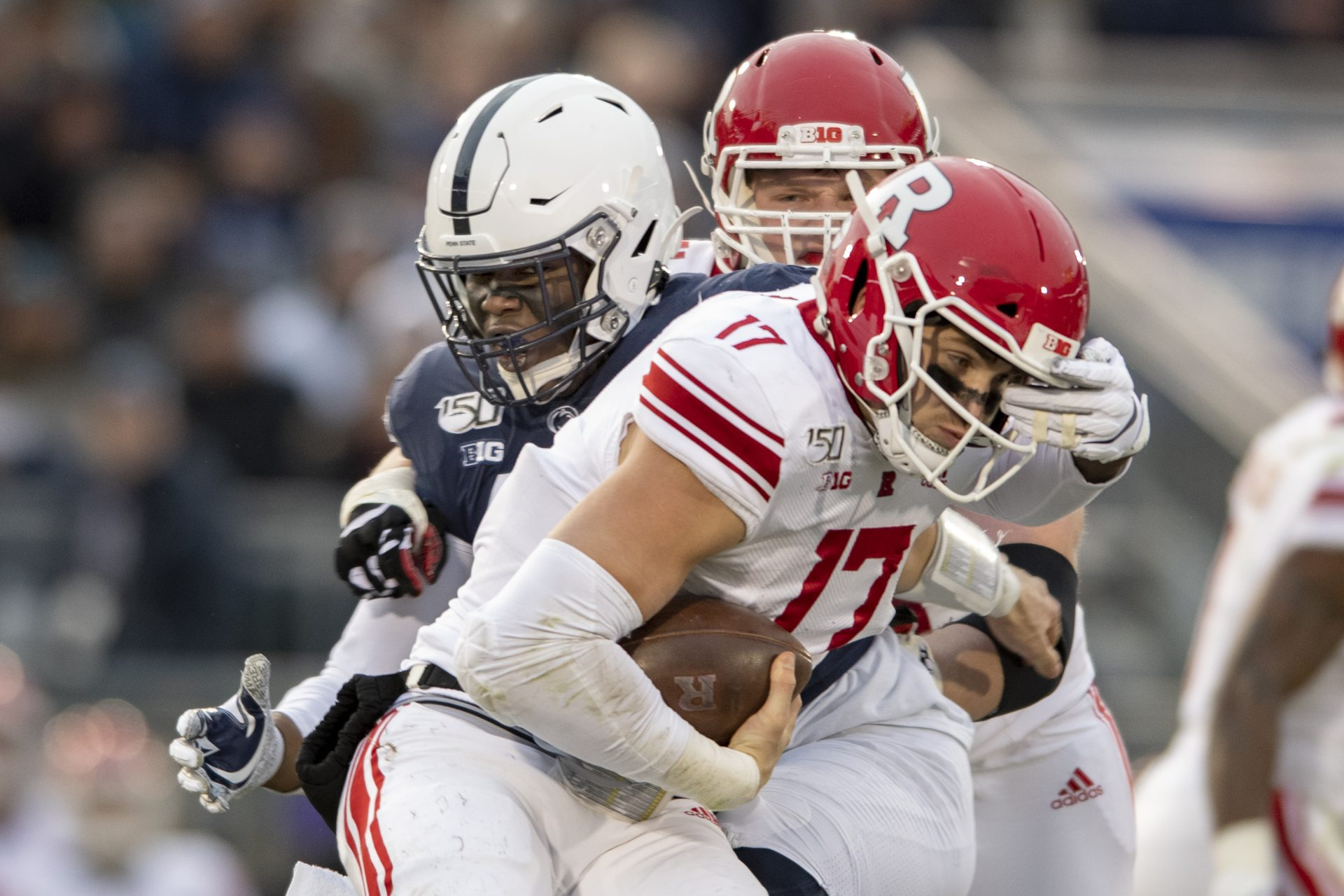 Penn State defensive end Daniel Joseph (49) sacks Rutgers quarterback Johnny Langan (17) in the second quarter of an NCAA college football game in State College, Pa., on Saturday, Nov. 30, 2019.