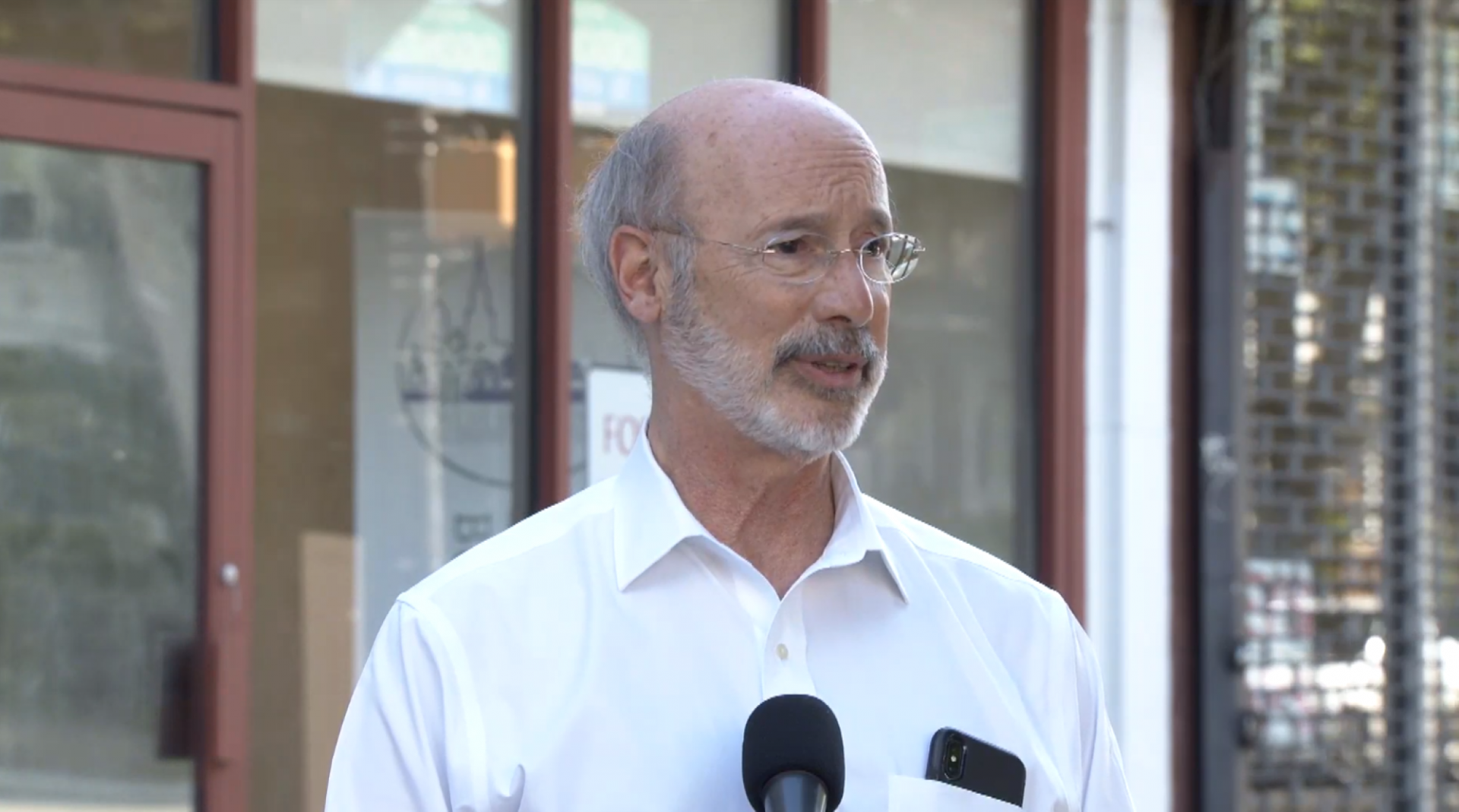 Gov. Tom Wolf speaks to reporters Monday evening in Philadelphia, where he was touring parts of the city damaged during the weekend's protests over the death of George Floyd in Minneapolis.