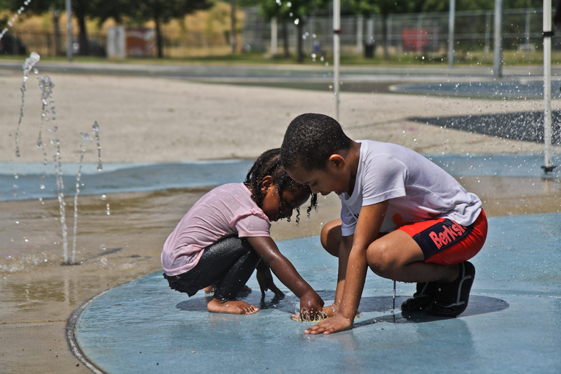 Spraygrounds in Philadelphia opened Monday, and kids at Mander playground were among the first to enjoy the streams.