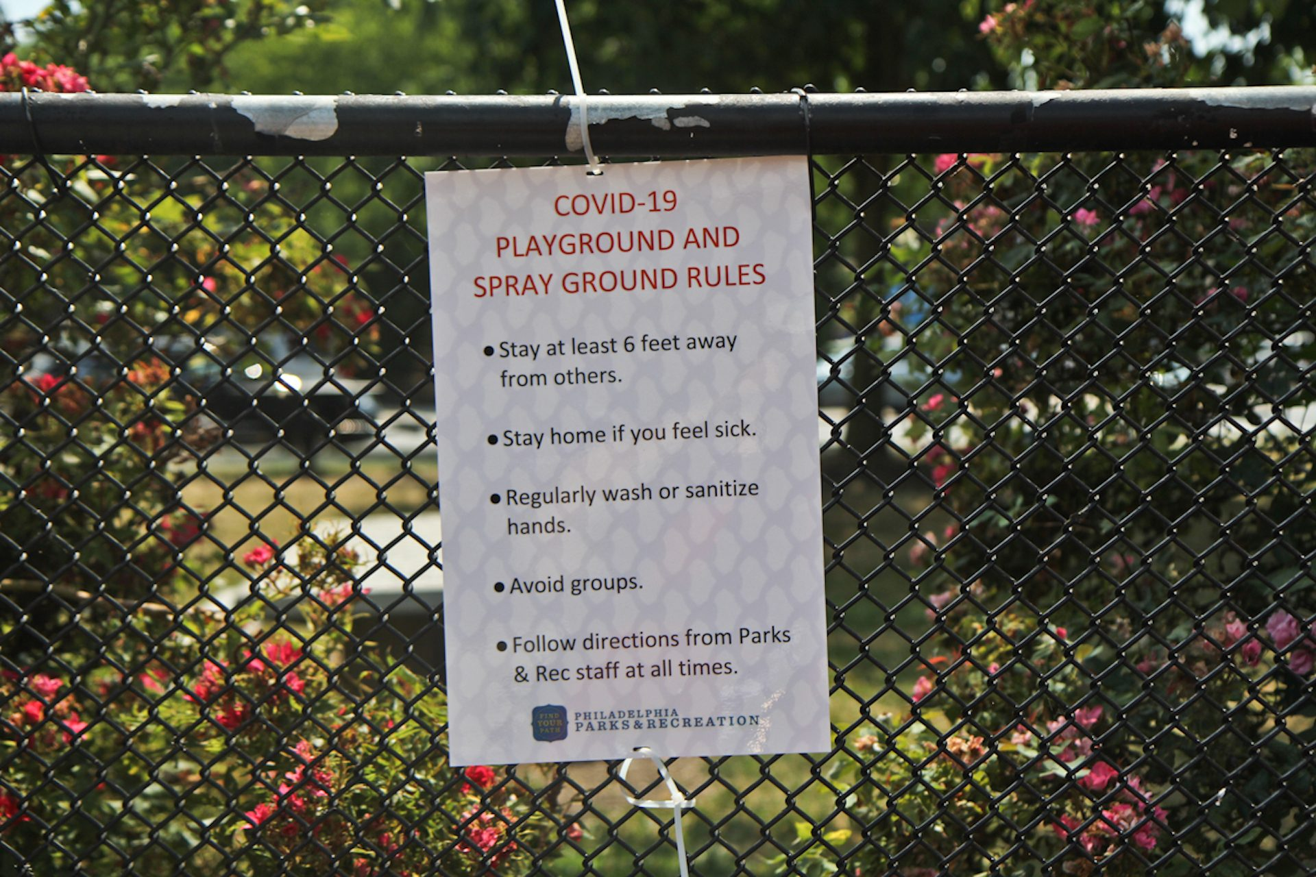 Guidelines to help stop the spread of COVID-19 are posted at Mander Playground in Philadelphia.