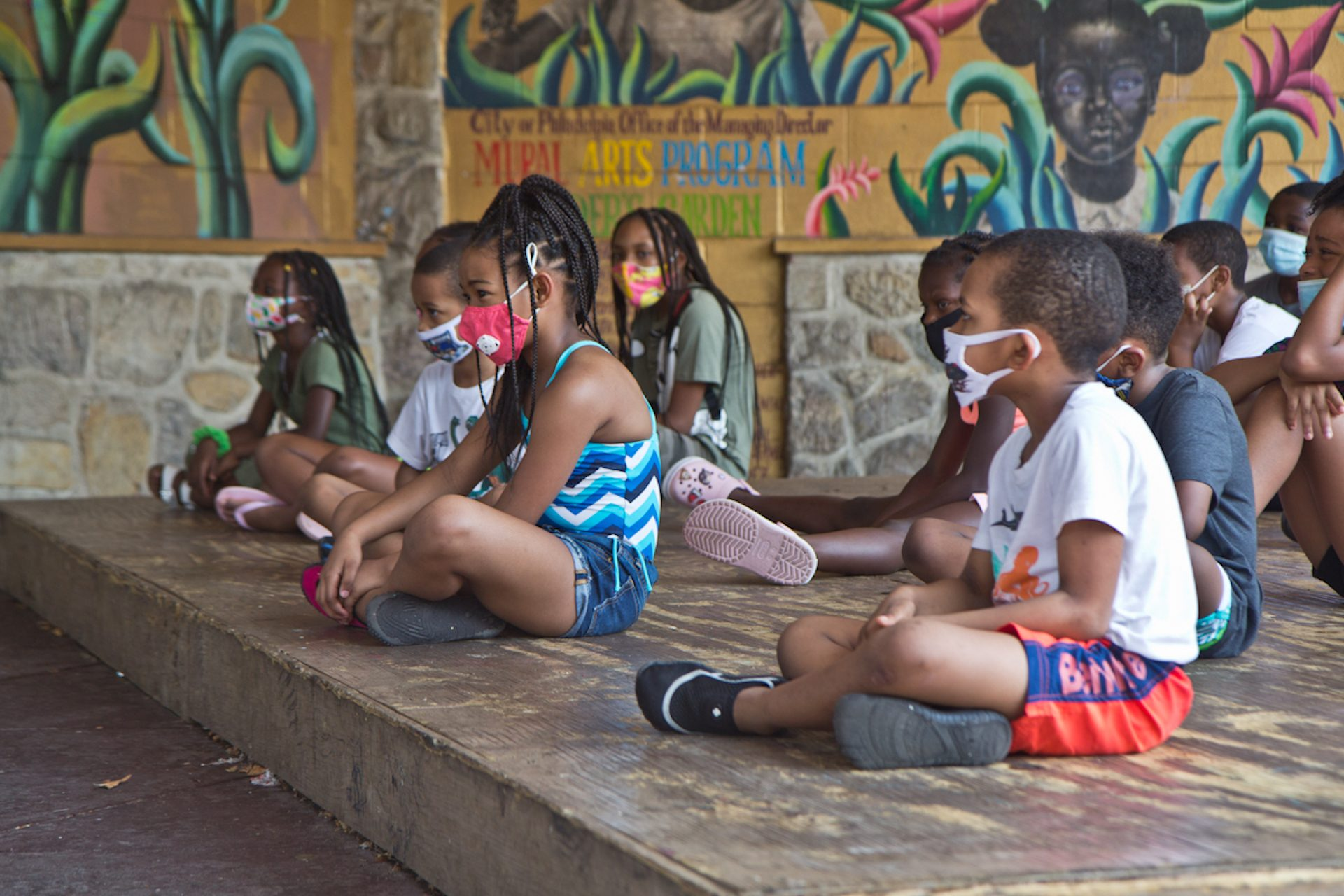 Kids at Mander playground wear masks on the first day of Philadelphia's Parks and Recreation Summer Camps.