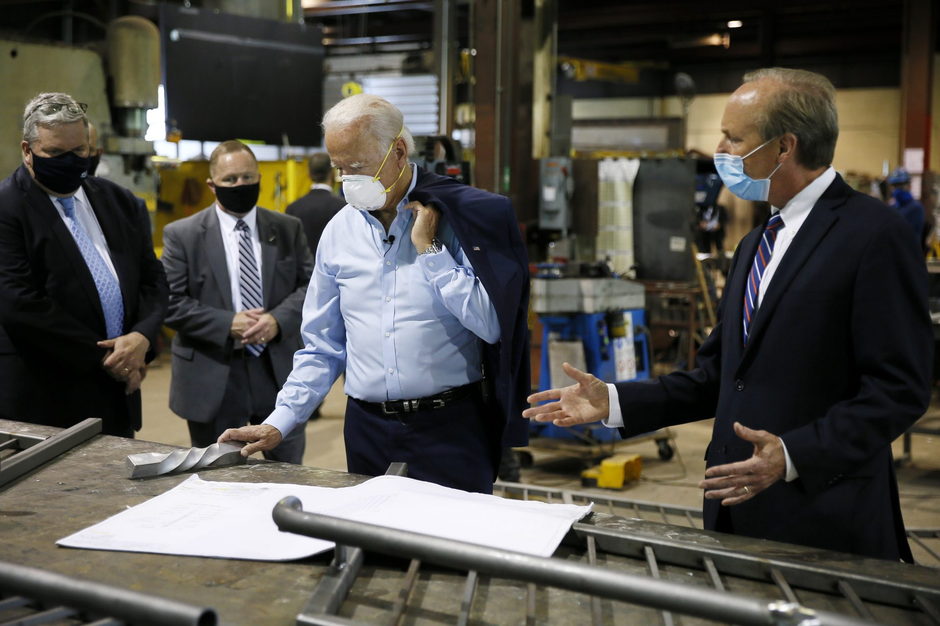 Democratic presidential candidate, former Vice President Joe Biden, center, listens to McGregor Industries owner Bob McGregor, right, give a tour of the metal fabricating facility, Thursday, July 9, 2020, in Dunmore, Pa.