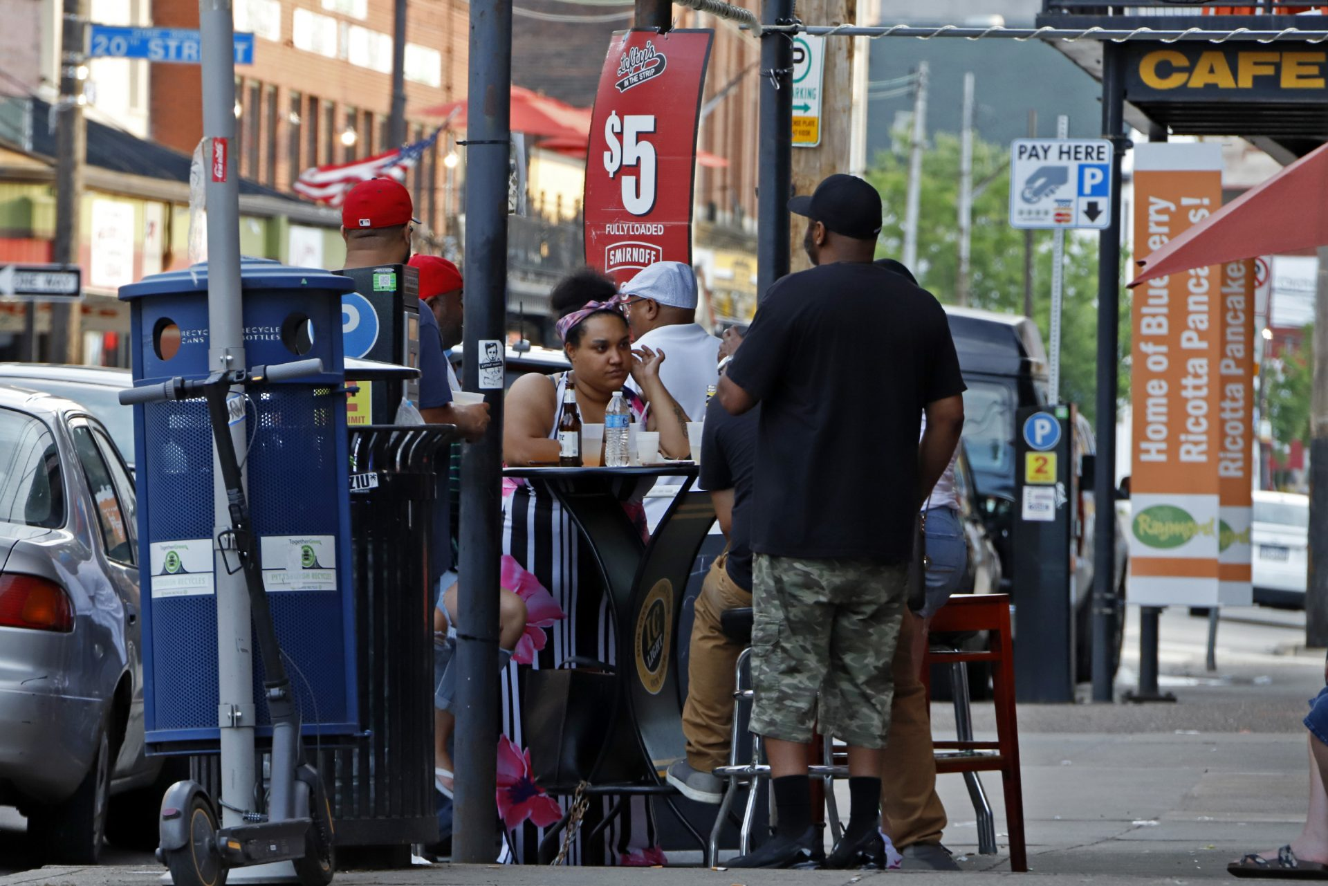 People gather at tables outside Lefty's bar in the Strip District of downtown Pittsburgh Sunday, June 28, 2020.