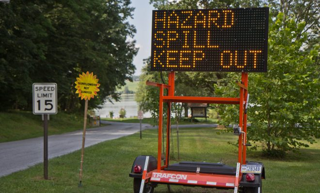 A sign warns visitors to Marsh Creek Lake at the entrance of Marsh Creek Lake State Park in Chester County, Pa., where about 8,000 gallons of drilling mud spilled due to construction of the Mariner East pipeline.